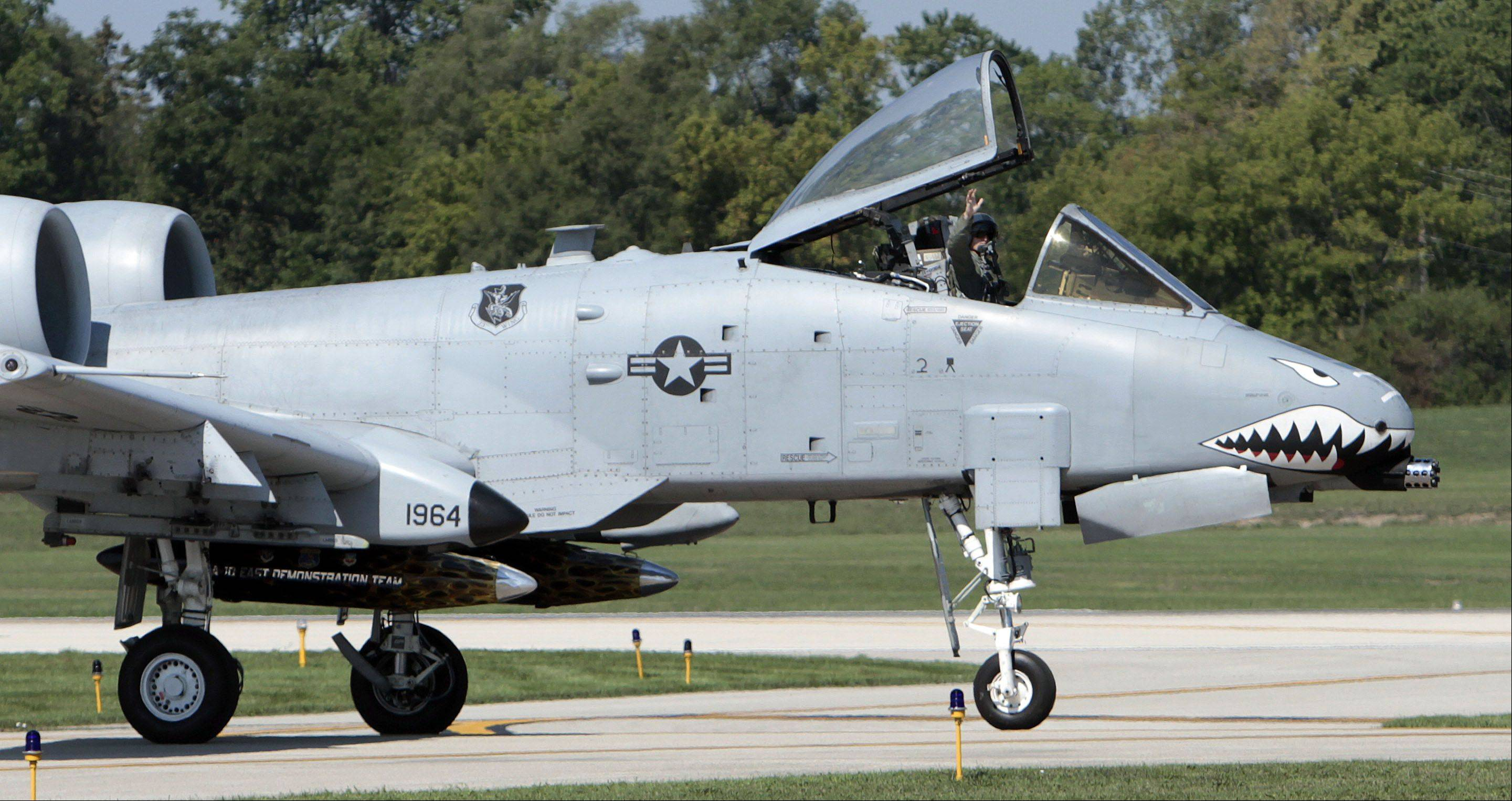 Libertyville native and Air Force Capt. Russell Campbell waves to family and friends after landing his A-10 Thunderbolt II at Waukegan Municipal Airport for the 2012 Wings of Waukegan air show Saturday.