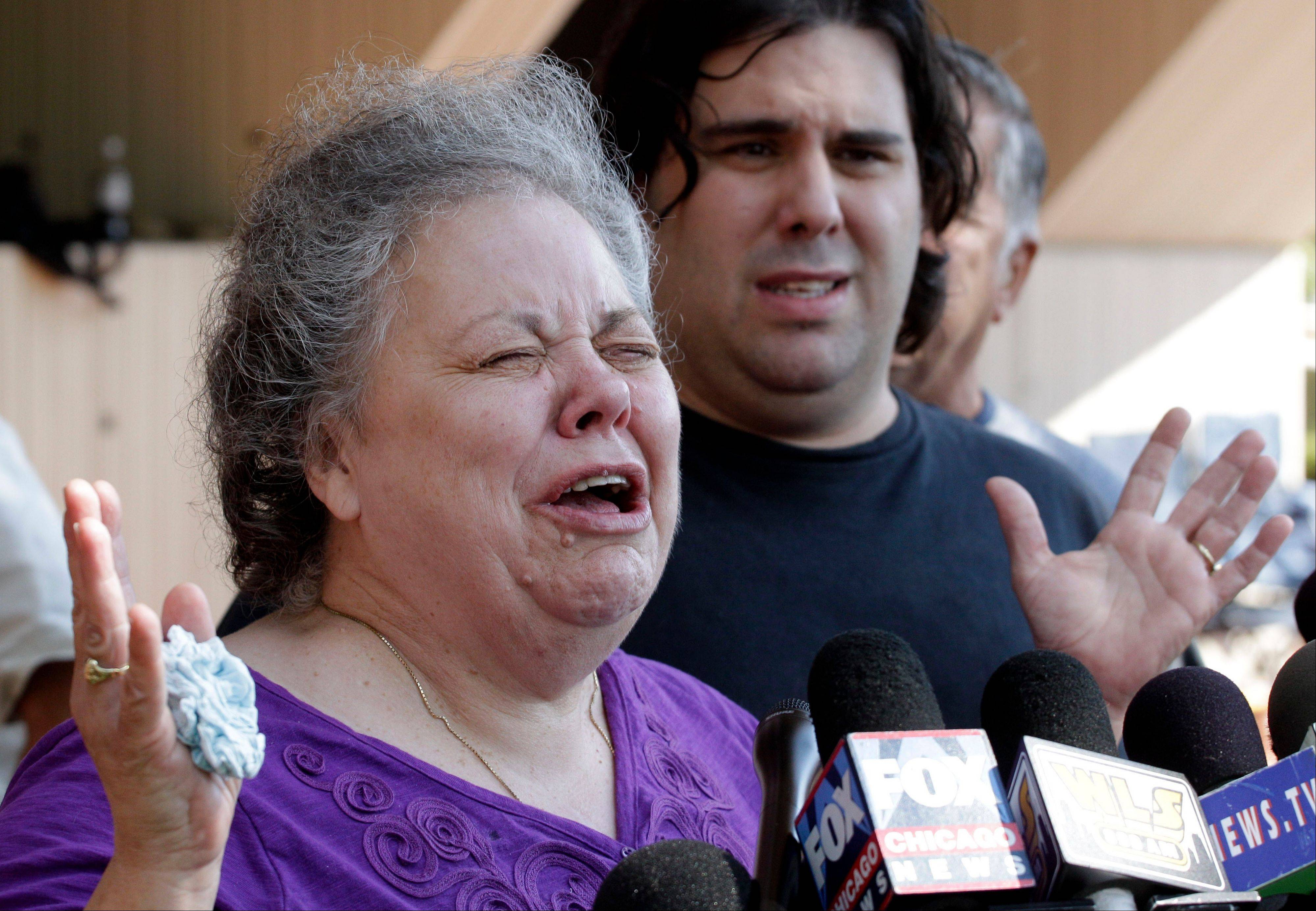 Marcia Savio, stepmother of Kathleen Savio, cries Thursday outside the Will County Courthouse after word that former Bolingbrook police officer Drew Peterson was found guilty of Kathleen Savio's murder. Marcia Savio is accompanied by Kathleen Savio's half-brother, Nicholas Savio.