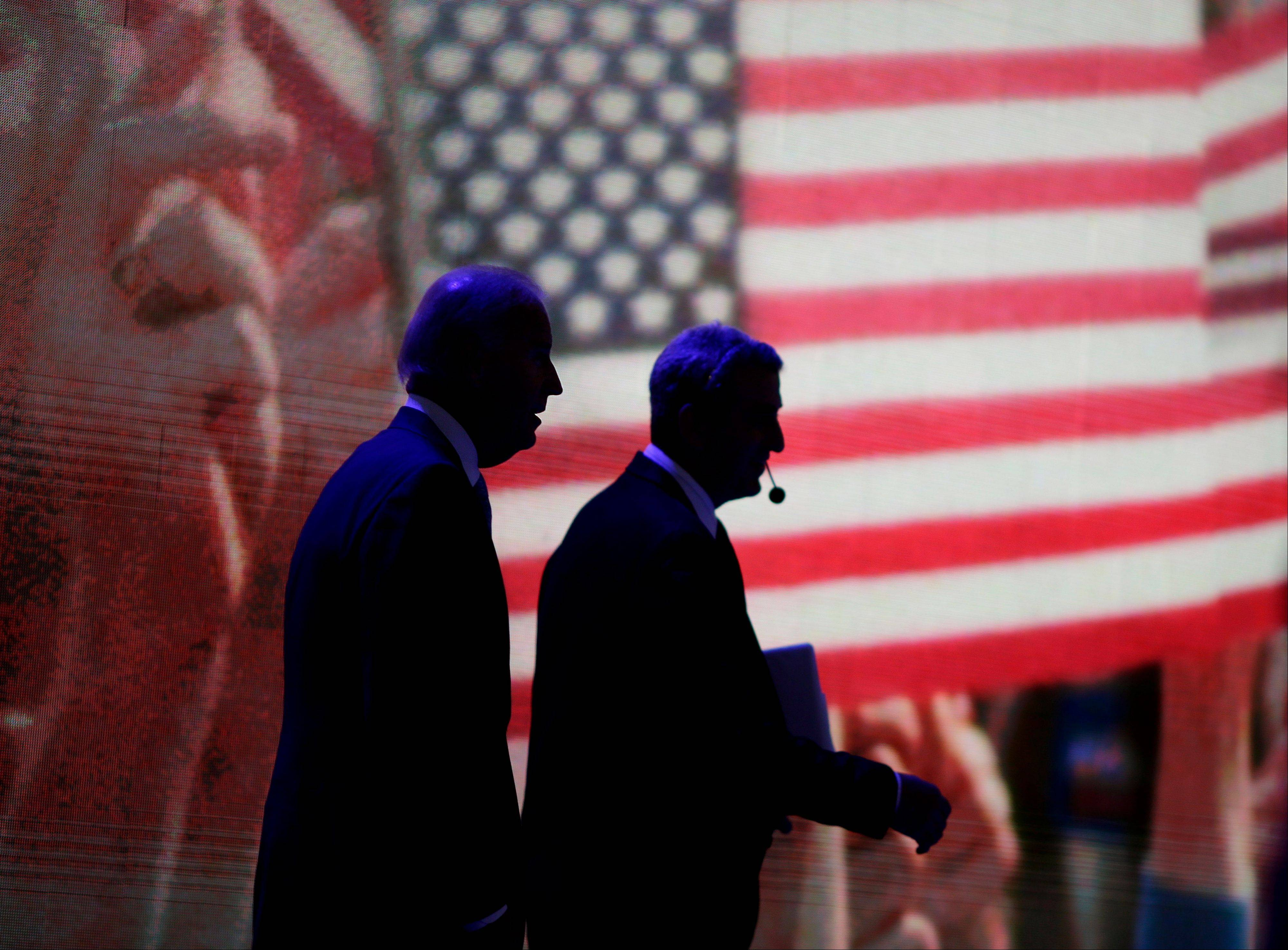 Vice President Joe Biden, left, walks out with a stage manager for a microphone check in preparation for his speech at the Democratic National Convention early Thursday, Sept. 6, 2012, in Charlotte, N.C.