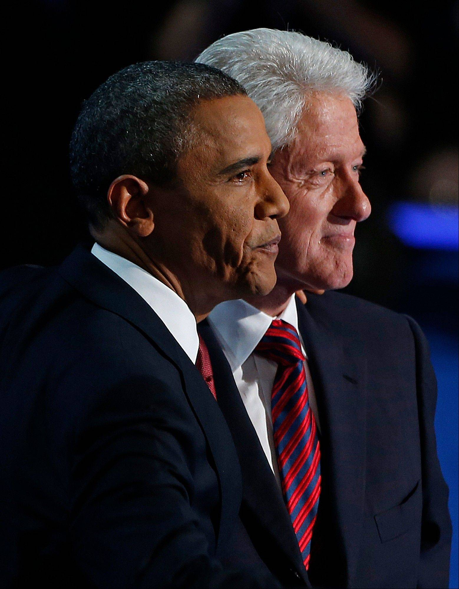 President Barack Obama stands with Former President Bill Clinton after Clintons' address to the Democratic National Convention in Charlotte, N.C., on Wednesday, Sept. 5, 2012.