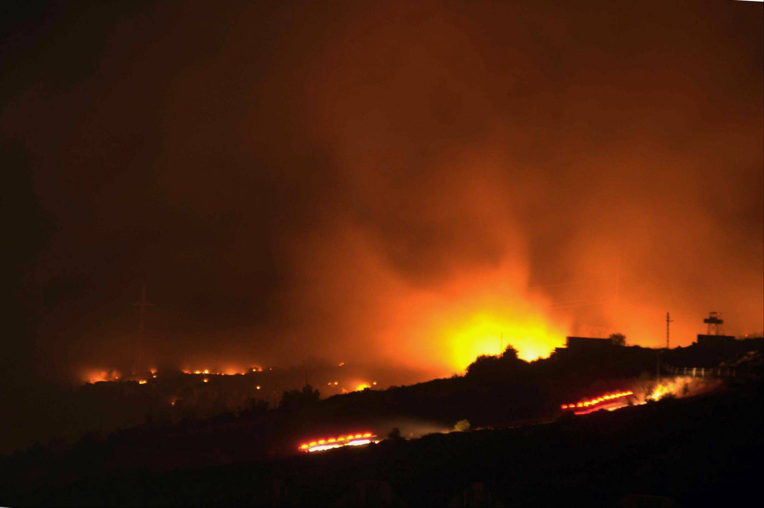 A glow of a large fire seen after an explosion at an ammunition store in Afyonkarahisar in western Turkey which has killed some 25 soldiers and wounded at least four others, Thursday, Sept. 6, 2012. The blast happened on Wednesday night at a military storage for hand grenades in Afyon, military said. Environment Minister Veysel Eroglu said the explosion was most likely caused by an accident.