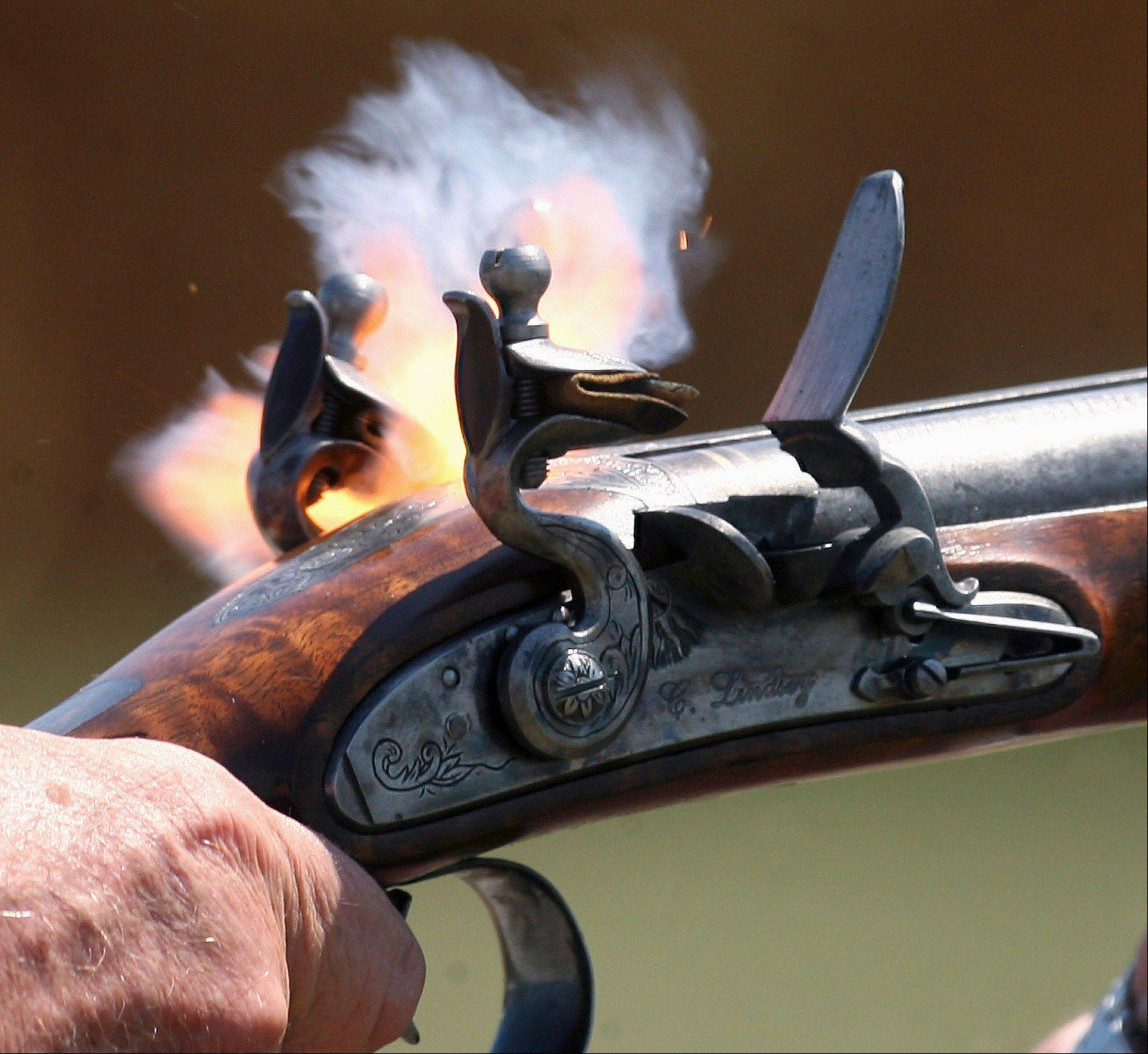 It all starts with a spark, as one barrel of a double-barreled shotgun made by Chuck Lindsey fires during a trapshooting session in rural southwest Logan County. Lindsey builds muzzleloading firearms, especially flintlocks that were in use in the late 18th and early 19th centuries.