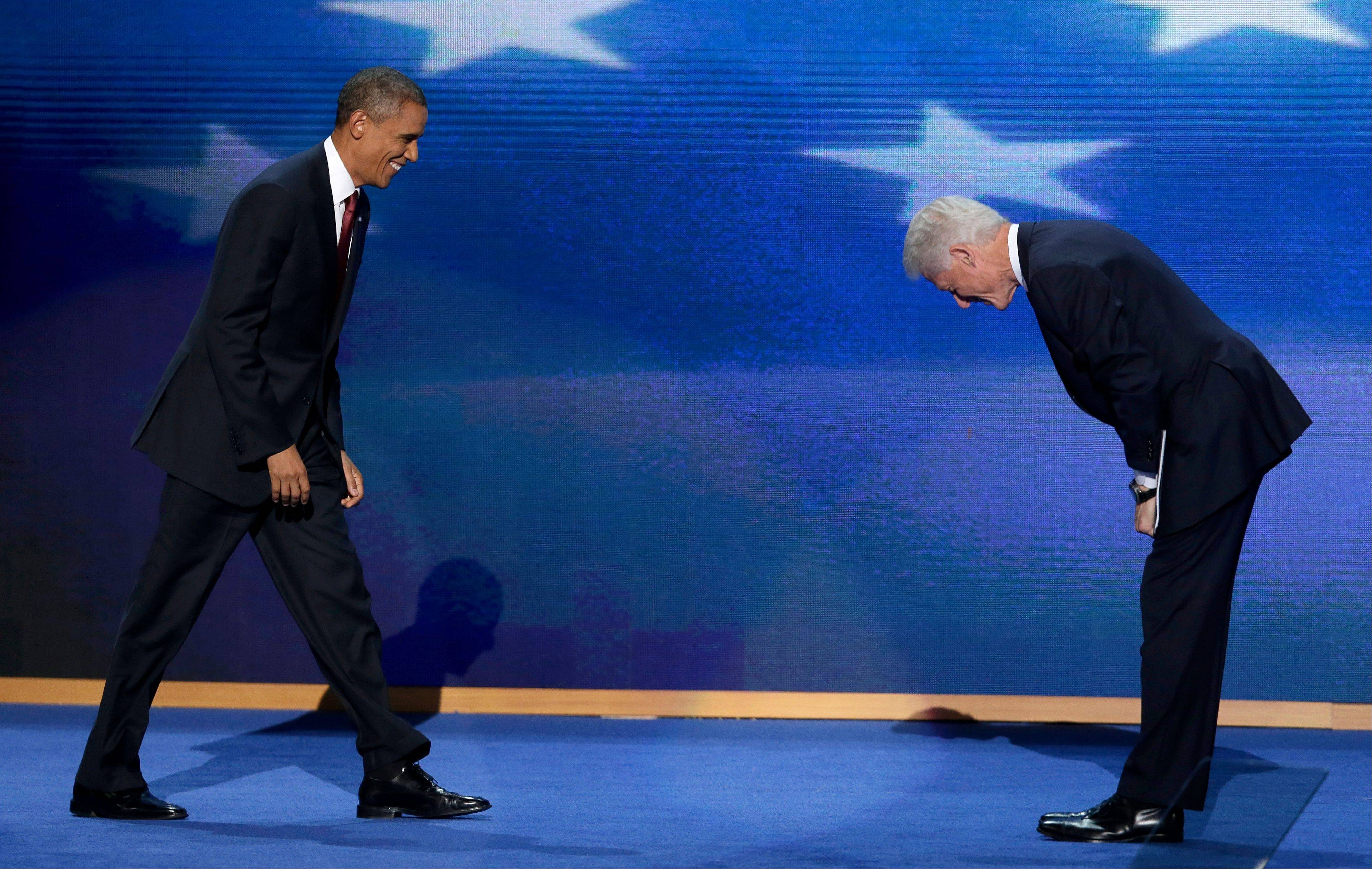 Former President Bill Clinton bows as President Barack Obama walks on stage after Clinton's address to the Democratic National Convention in Charlotte, N.C., on Wednesday.
