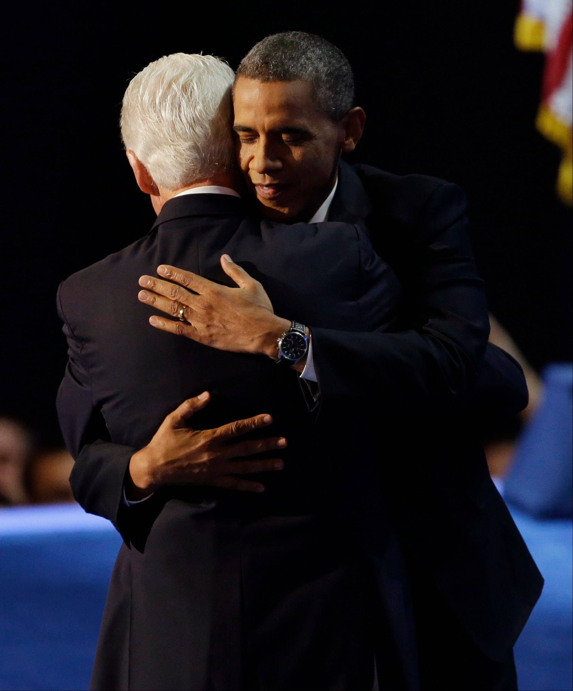President Barack Obama, right, hugs former President Bill Clinton after Clinton's speech to the Democratic National Convention in Charlotte, N.C., on Wednesday.