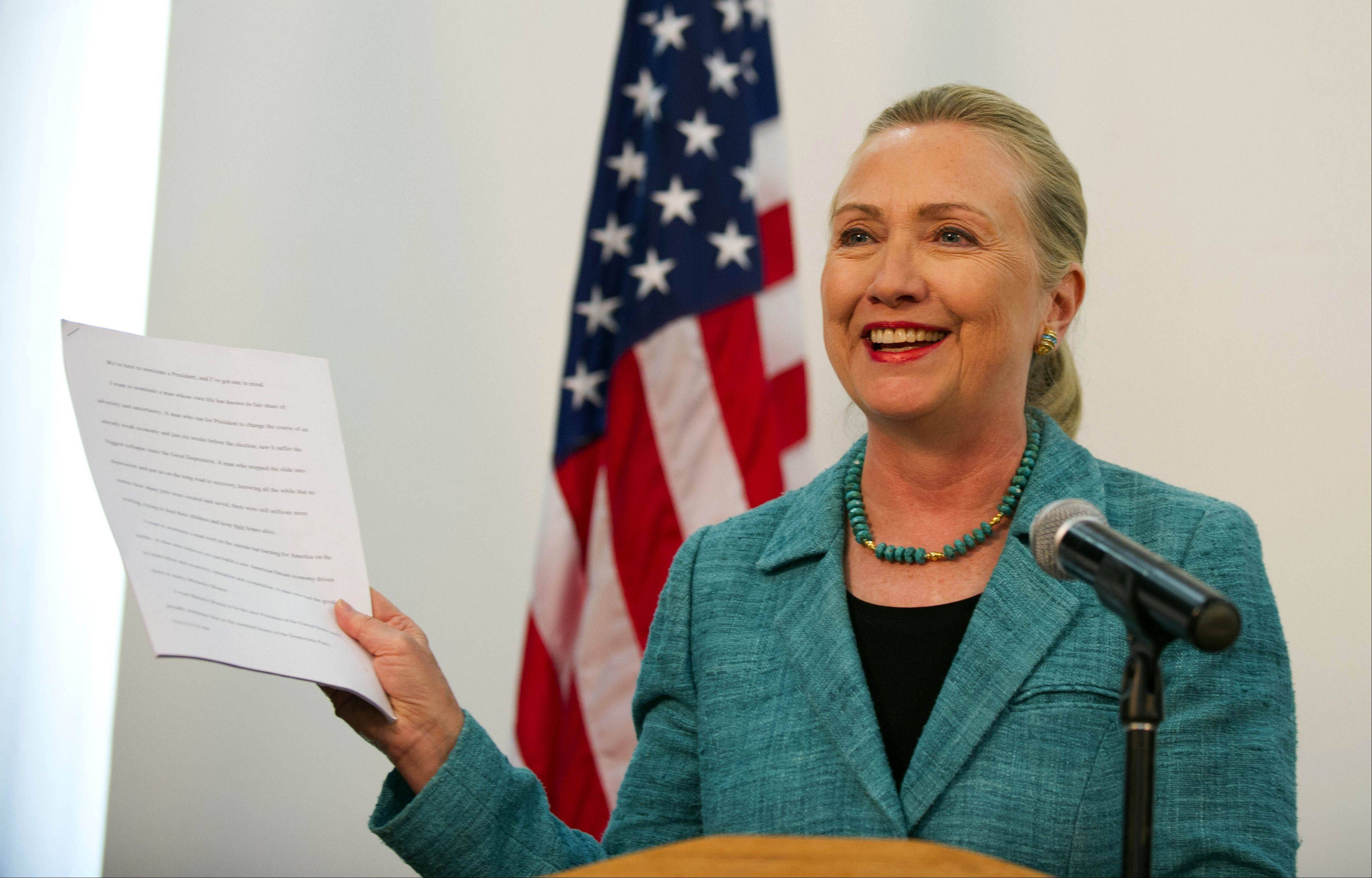 "U.S. Secretary of State Hillary Rodham Clinton shows paperwork as she refers to the ""As Prepared"" version of former President Bill Clinton's Democratic National Convention speech that she said she had read. She was in a joint press conference with East Timor Prime Minister Xanana Gusmao at the Government Palace in Dili, East Timor, Thursday."