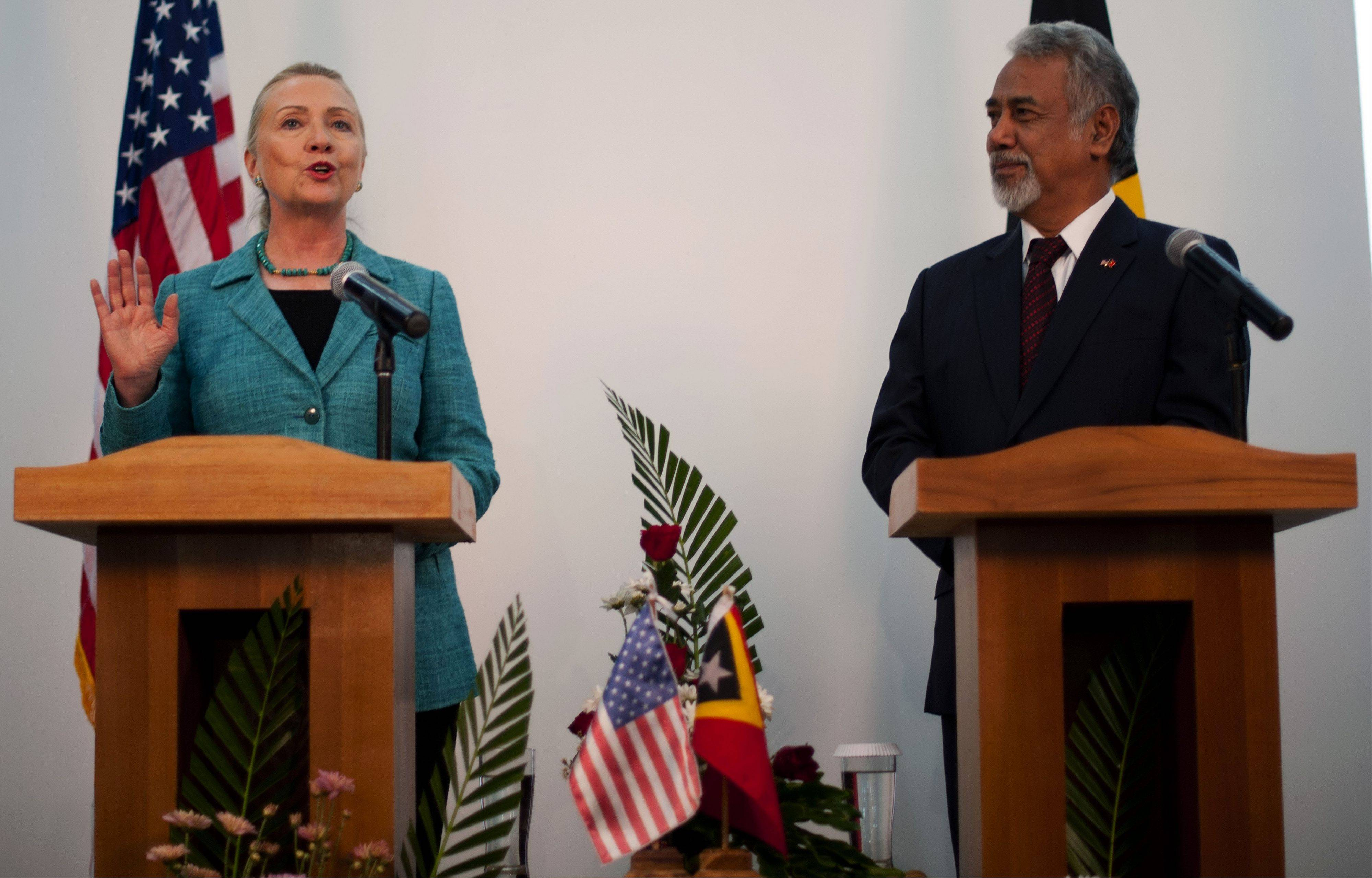 U.S. Secretary of State Hillary Rodham Clinton, left, speaks as East Timor Prime Minister Xanana Gusmao looks on during a joint press conference at the Government Palace in Dili, East Timor, Thursday. Clinton is in East Timor to offer the small half-island nation support as it ends its reliance on international peacekeepers.
