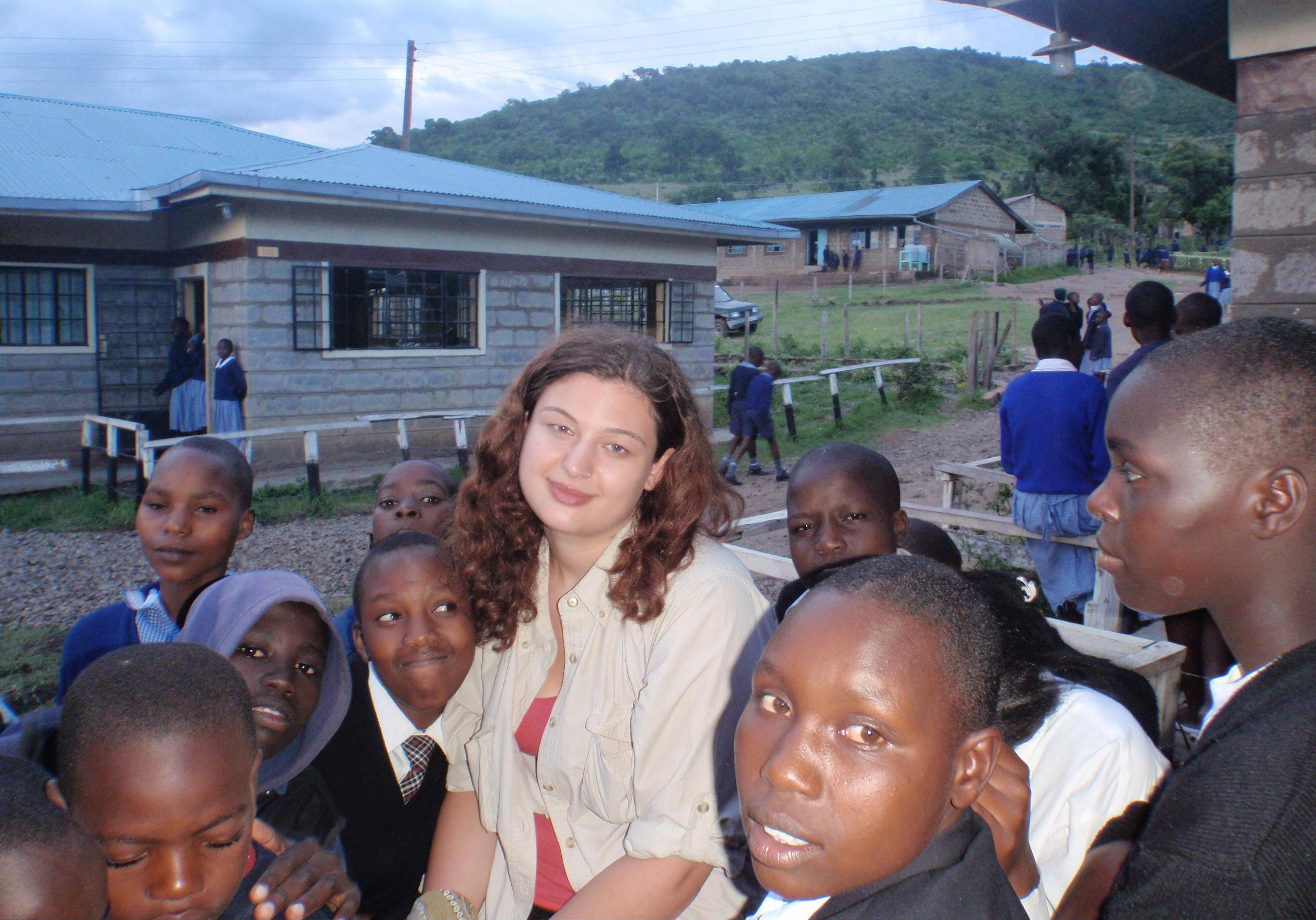 Aliya with children in the tiny Kenyan village of Mulot.