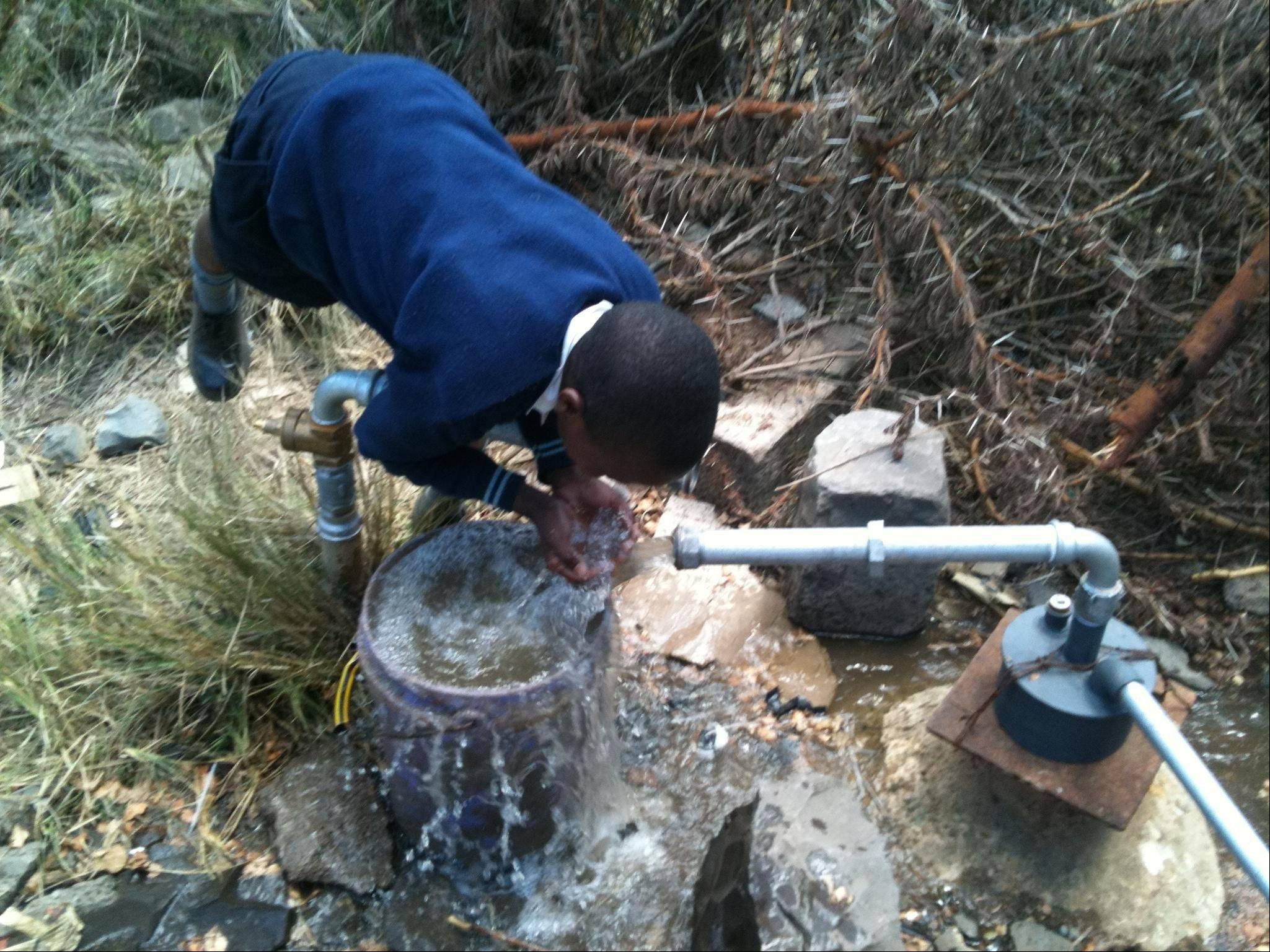 After Aliya de Grazia of Long Grove started volunteering at a Catholic mission in the tiny Kenyan village of Mulot, she started a charity that built a well to provide clean water.