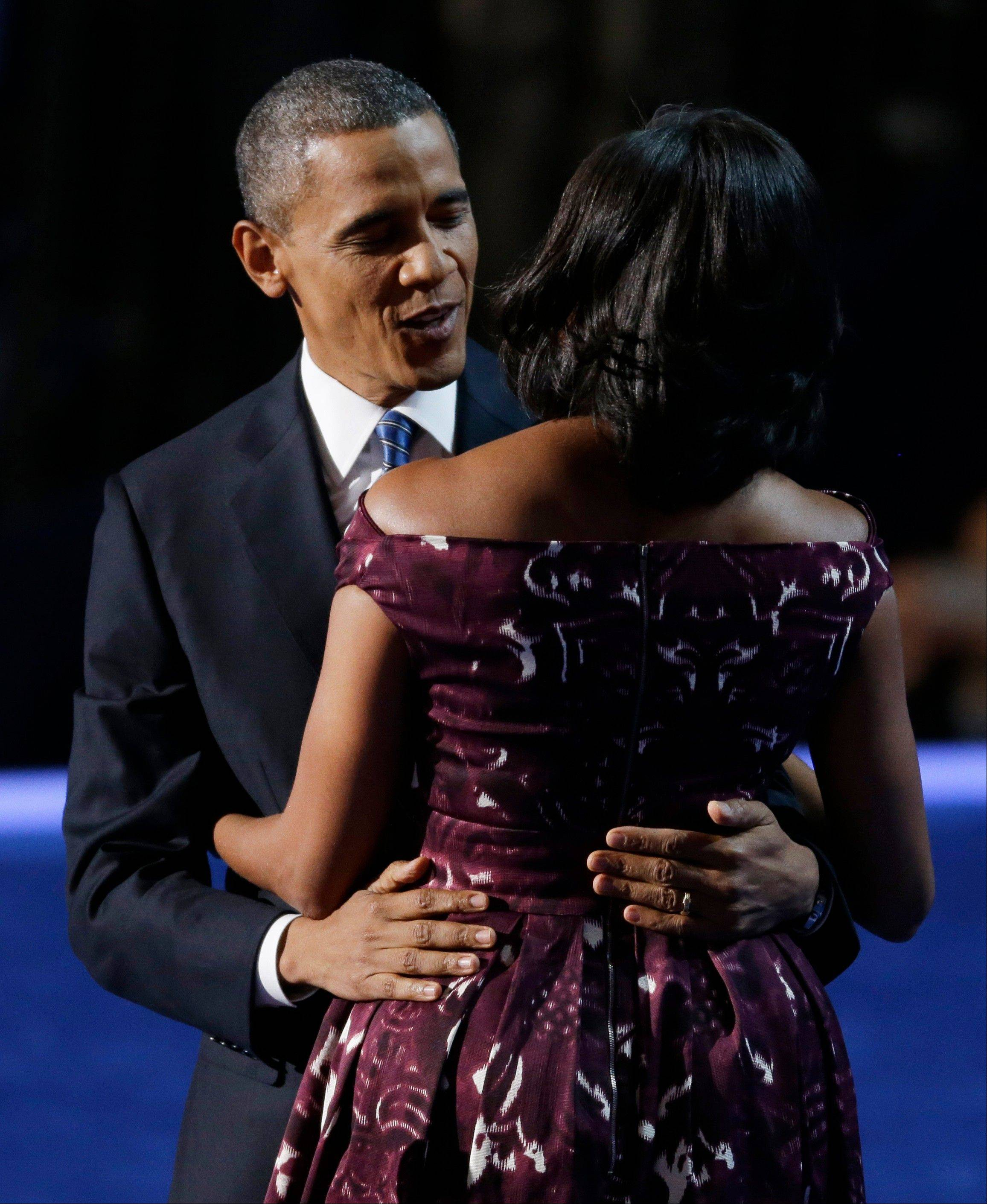 President Barack Obama hugs his wife, first lady Michelle Obama, at the Democratic National Convention in Charlotte, N.C., on Thursday, Sept. 6, 2012.