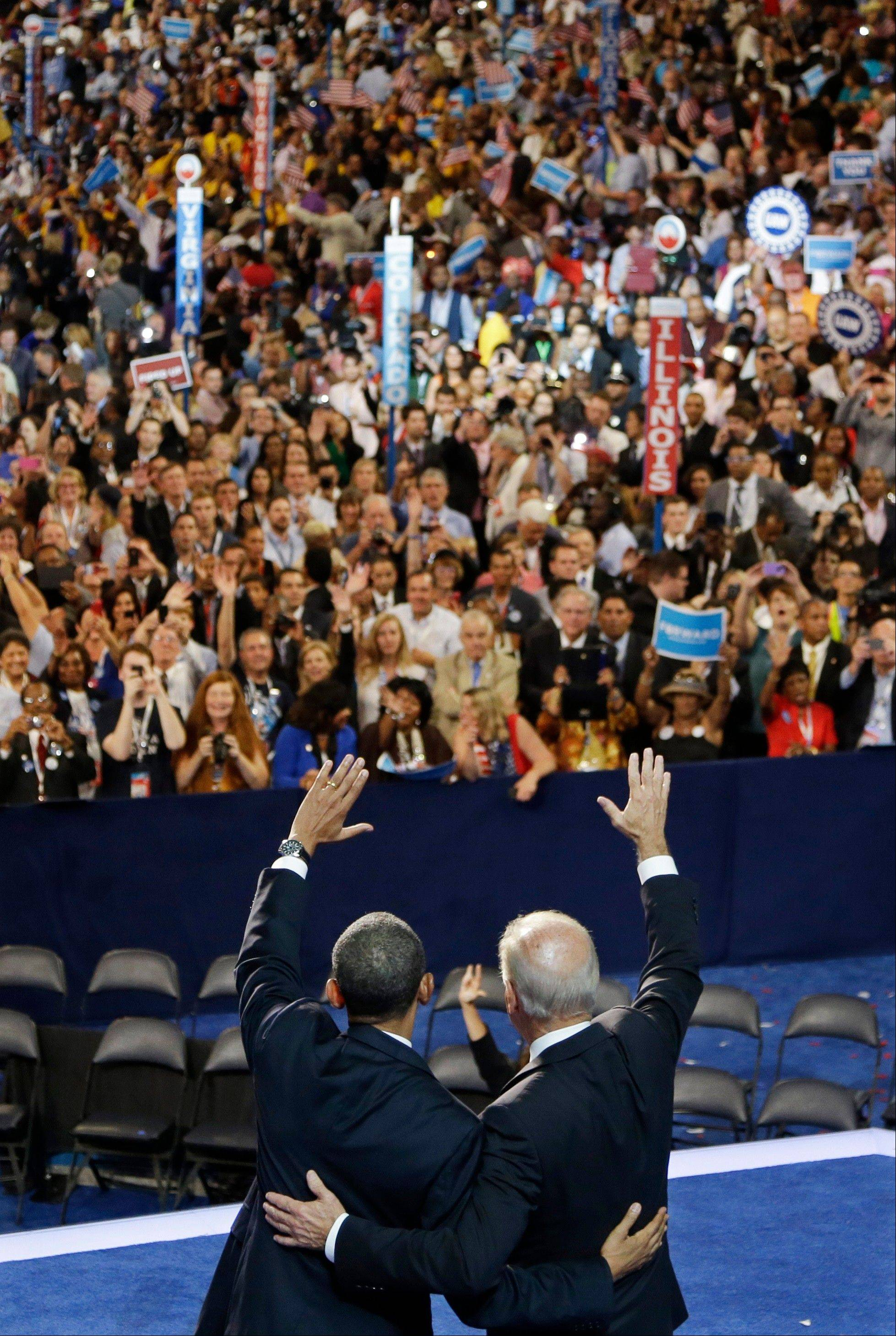 President Barack Obama, left, and Vice President Joe Biden wave to delegates at the Democratic National Convention in Charlotte, N.C., on Thursday, Sept. 6, 2012.