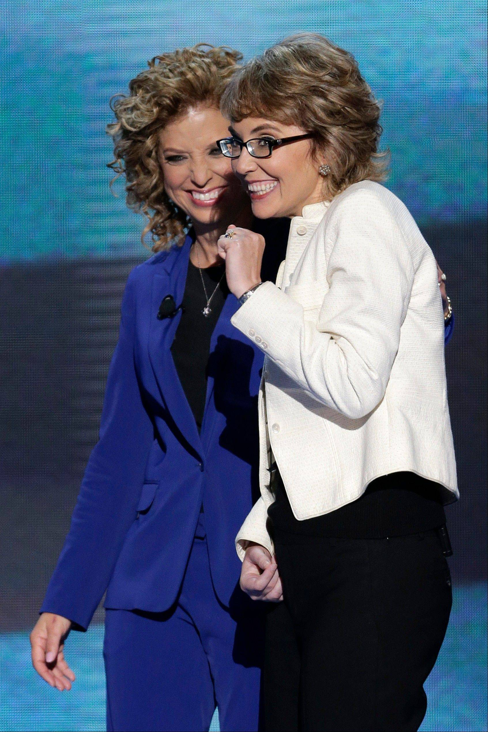 Former Rep. Gabrielle Giffords reacts after reciting the Pledge of Allegiance with Democratic National Committee Chairwoman Rep. Debbie Wasserman Schultz of Florida at the Democratic National Convention in Charlotte, N.C., on Thursday, Sept. 6, 2012.