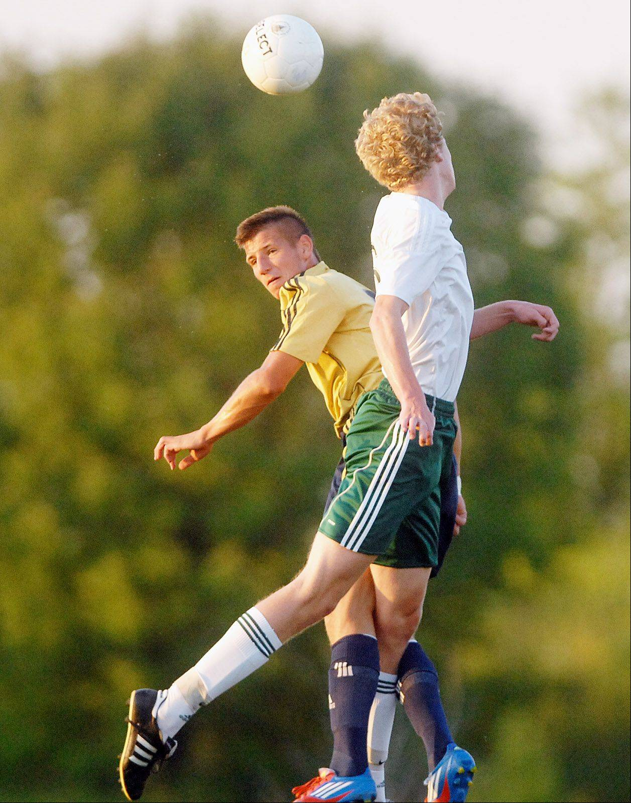 Jake Loncar of Neuqua,left, and Jack Cordes of Waubonsie go up for a ball during the Neuqua Vally at Waubonsie Valley boys Soccer game Thursday.
