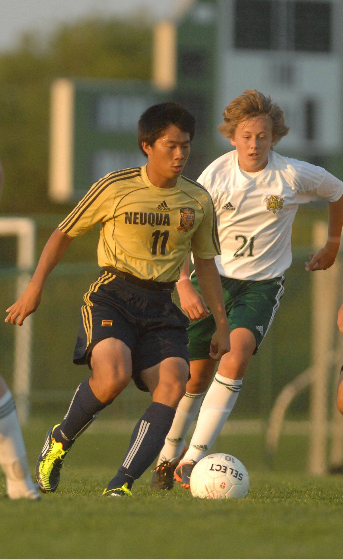 Alex Liu,left, and Michael Miller run after the ball during the Neuqua Valley at Waubonsie Valley boys Soccer game Thursday.