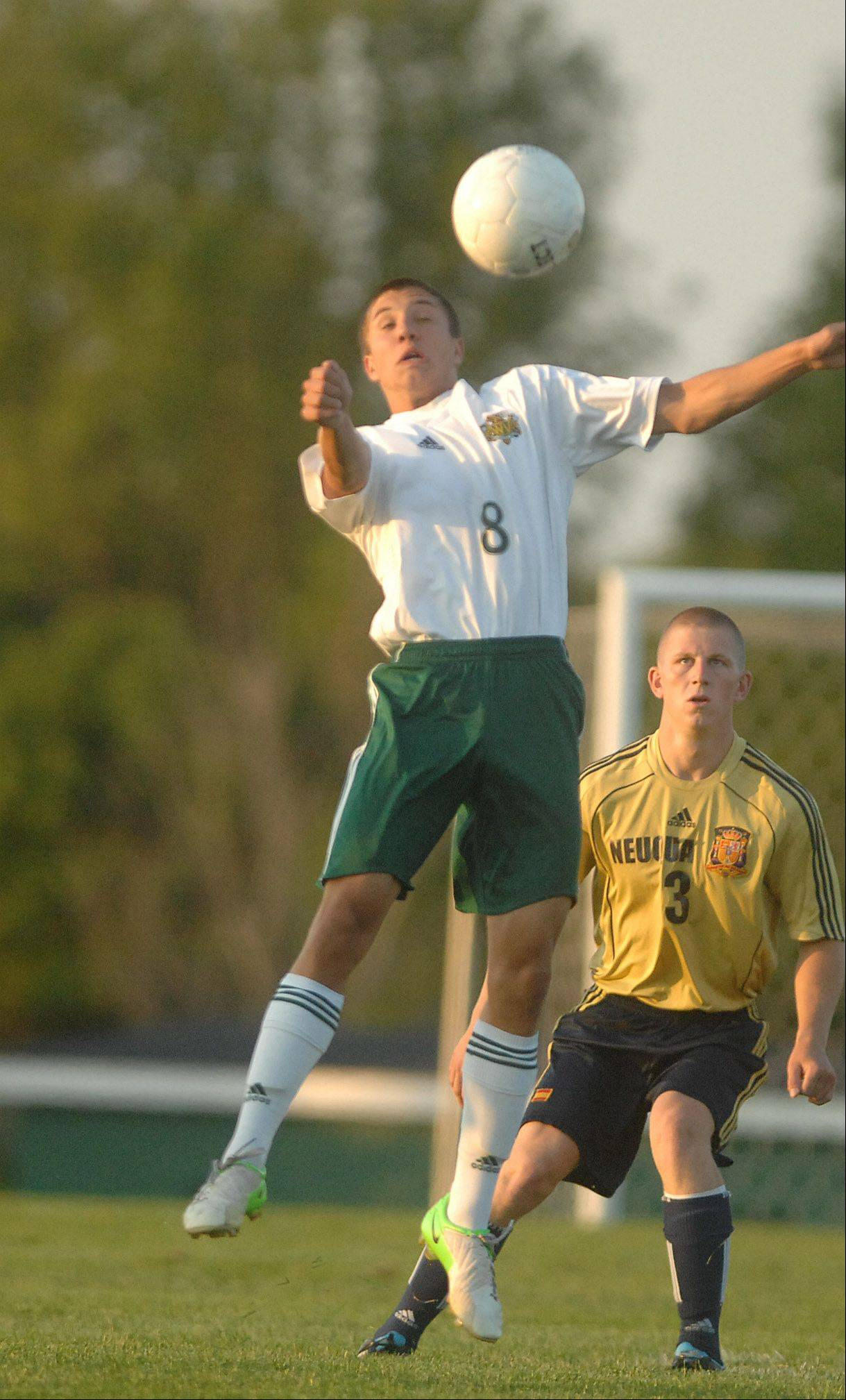 Casey Bucz of Waubonsie goes up for a ball during the Neuqua Valley at Waubonsie Valley boys Soccer Thursday.