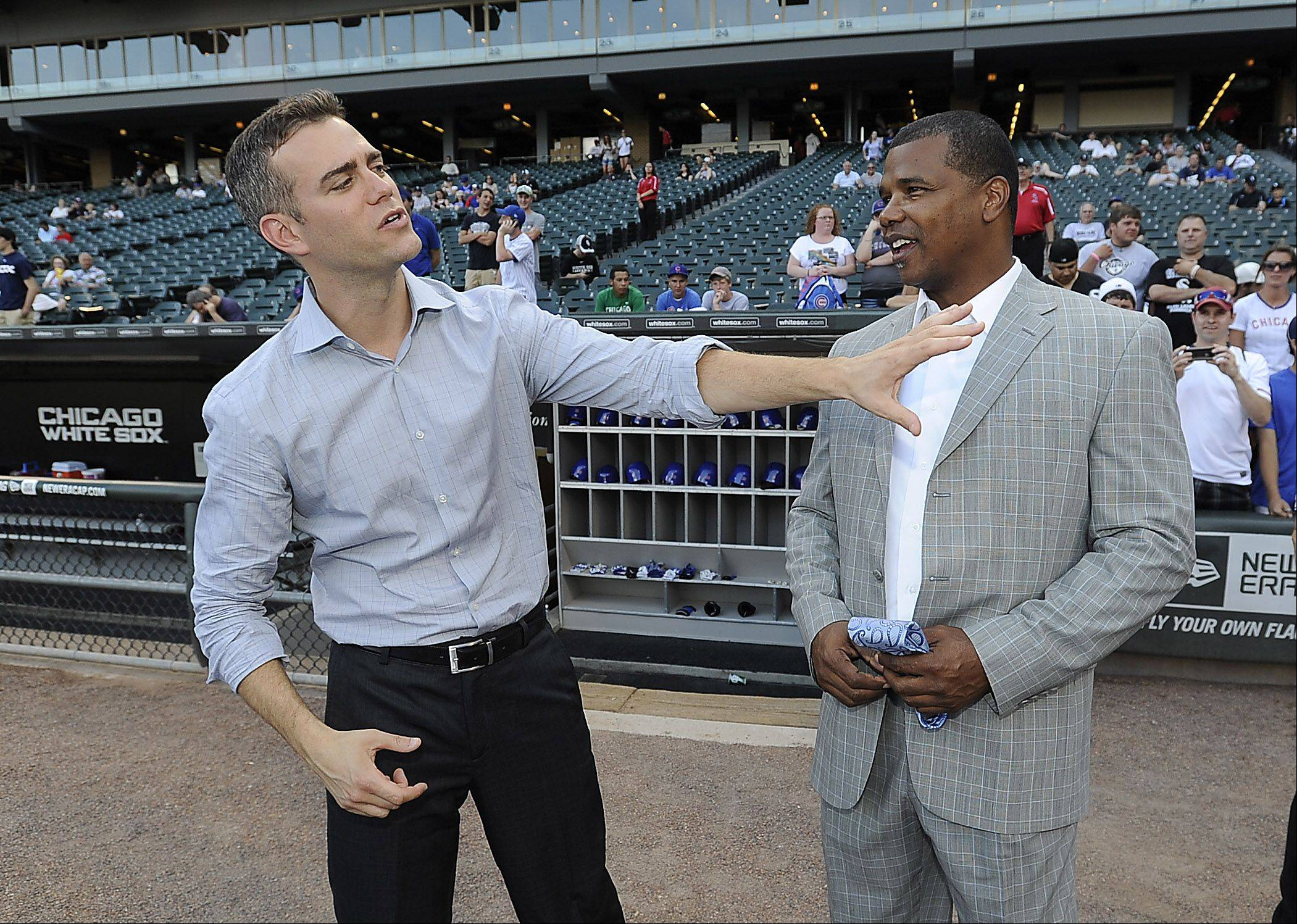 White Sox general manager Kenny Williams, here at right talkin with Cubs president of baseball operations Theo Epstein, likes a lot of what he some of his minor-leaguers have been doing recently.