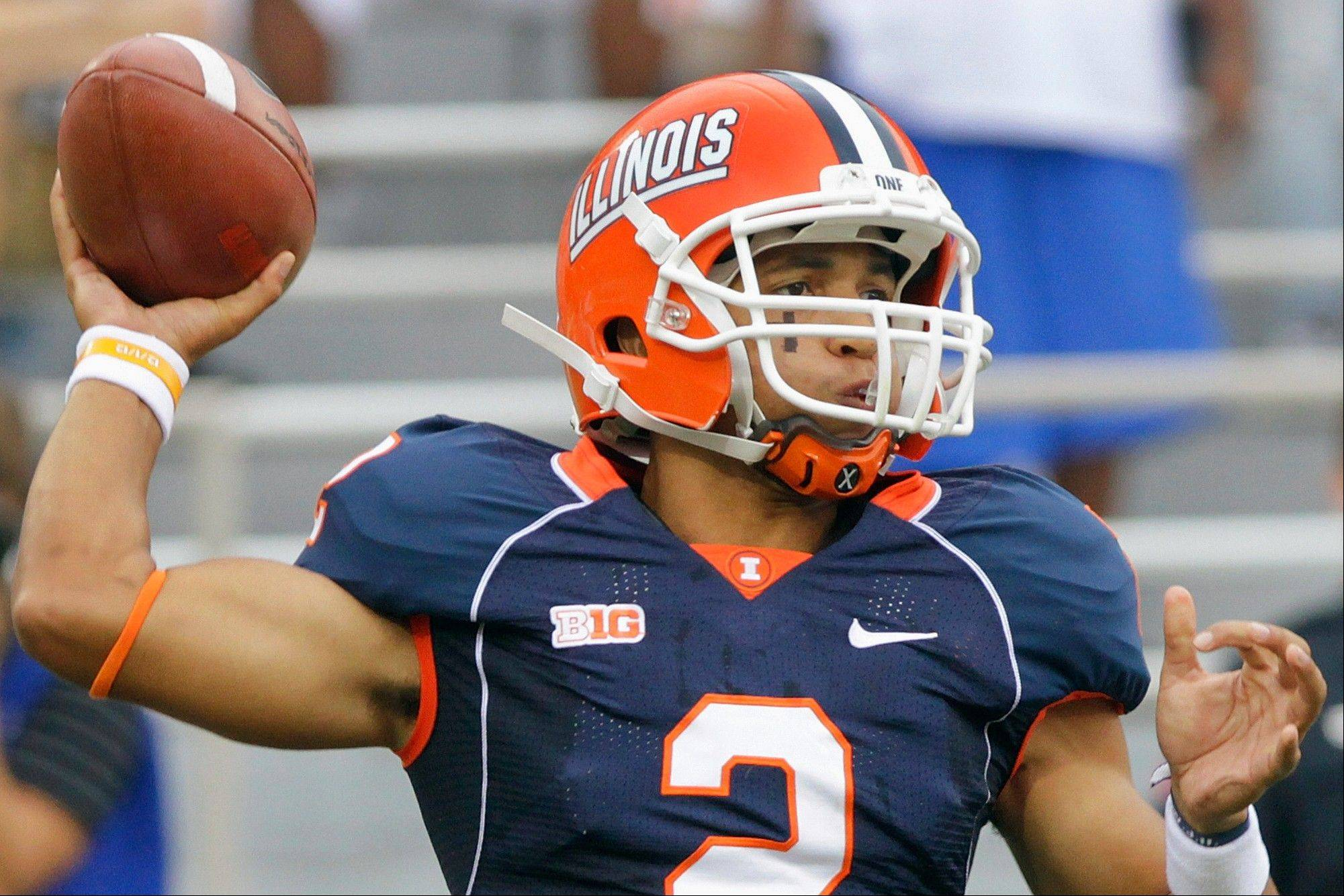In this photo taken Sept. 1, 2012, Illinois quarterback Nathan Scheelhaase passes against Western Michigan during an NCAA college football game in Champaign, Ill. Head coach Tim Beckman isn't expected to announce whether Scheelhaase, who injured his ankle in the game, will be allowed to play Saturday, Sept. 8 at Arizona State. Scheelhaase did practice Wednesday and may be able to play.