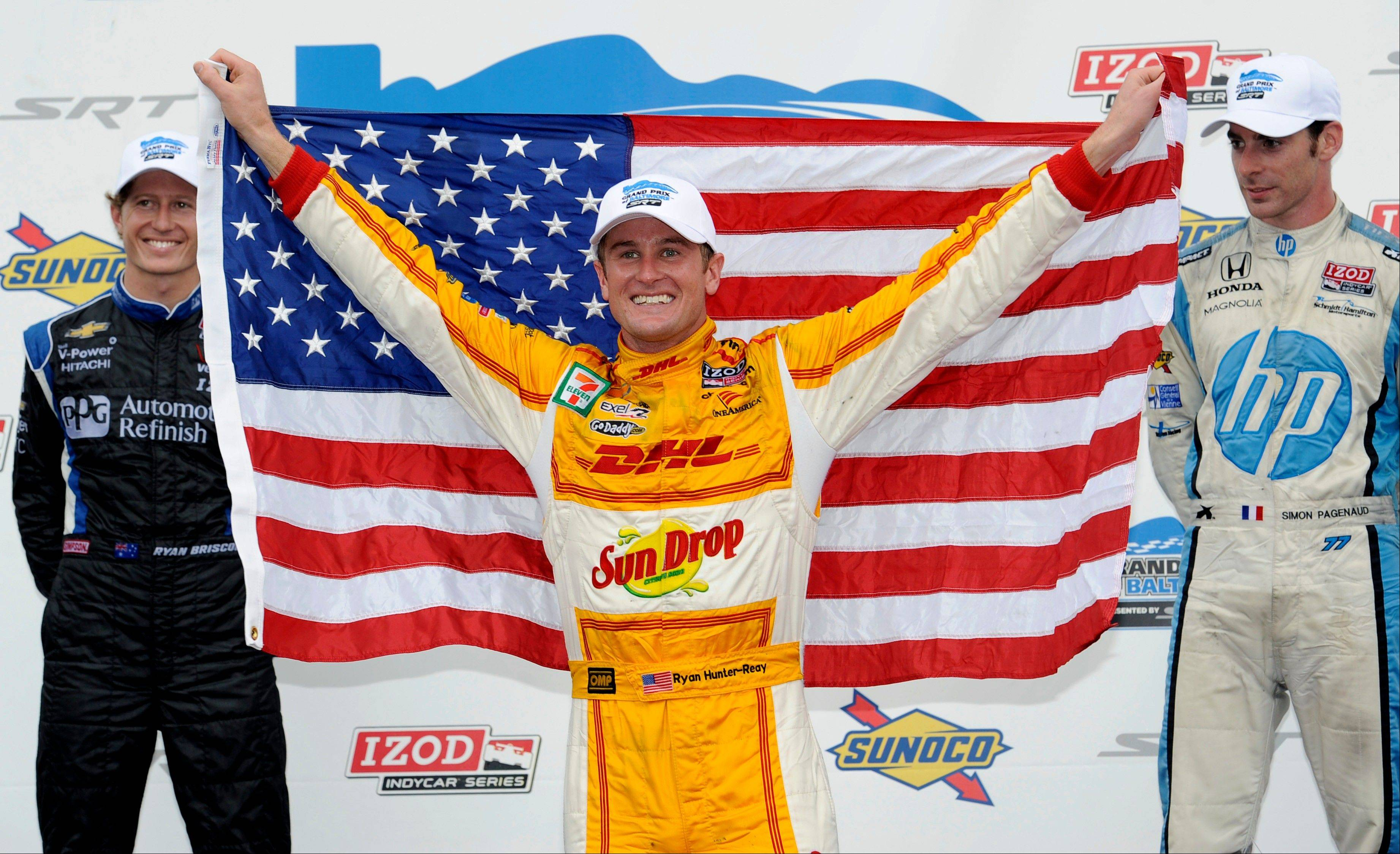 Associated PressRyan Hunter-Reay celebrates in victory lane after winning the IZOD IndyCar Grand Prix of Baltimore Sunday. At left is runner up Ryan Briscoe of Australia, and at right is Simon Pagenaud of France, third-place finisher.