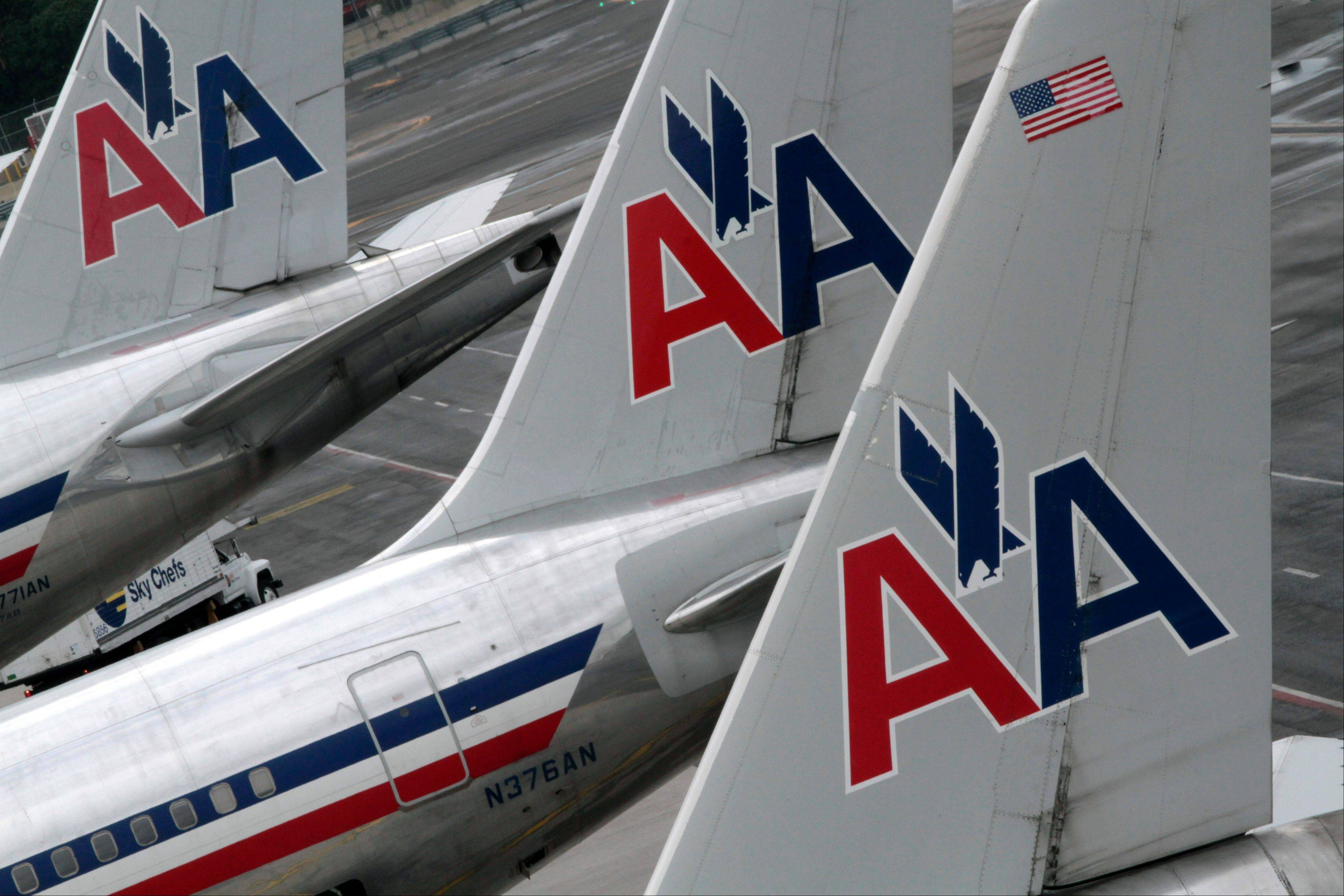 American Airlines airplanes are at parked at the gate at JFK International airport in New York.