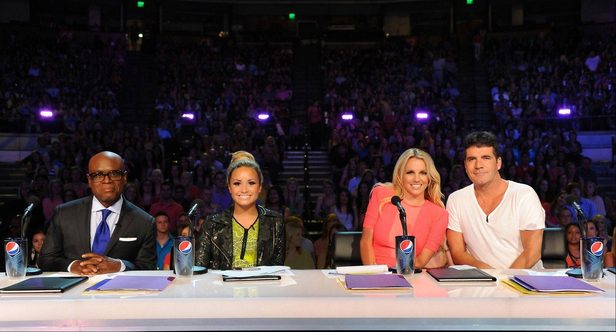 "Britney Spears, second from left, makes her judging debut Sept. 12 on Fox's ""The X Factor."" Also at the judge's table will be L.A. Reid, left, Demi Lovato and Simon Cowell."
