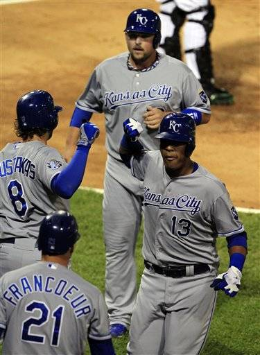 Lorenzo Cain hit two home runs, including a tie-breaking, two-run shot in the ninth inning, as the Kansas City Royals beat the White Sox 7-5 on Friday night.