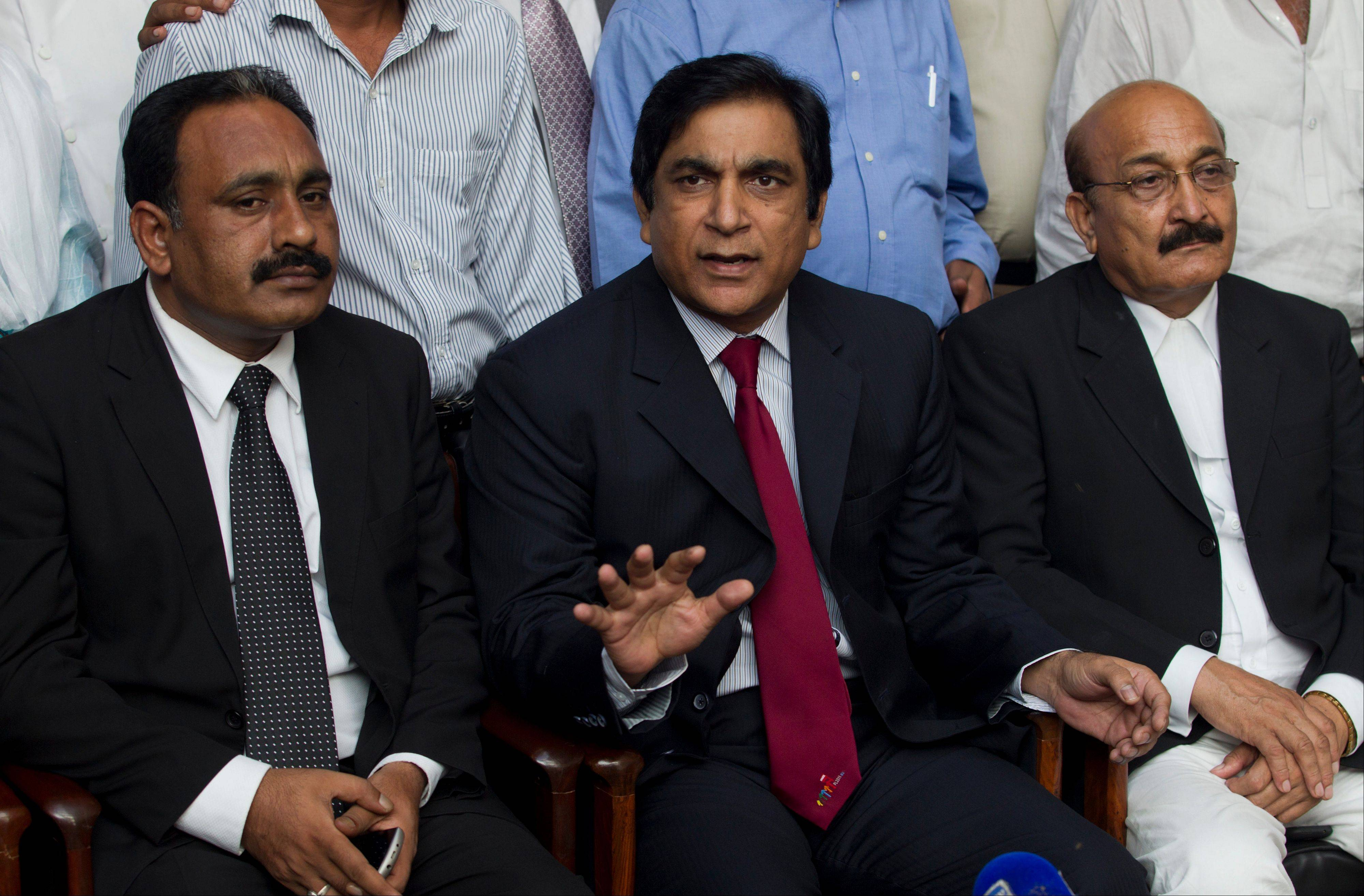 Paul Bhatti, center, an advisor to the prime minister of Pakistan on minorities affairs, flanked by lawyers of a Pakistani girl accused of blasphemy, addresses a news conference Friday in Islamabad, Pakistan.