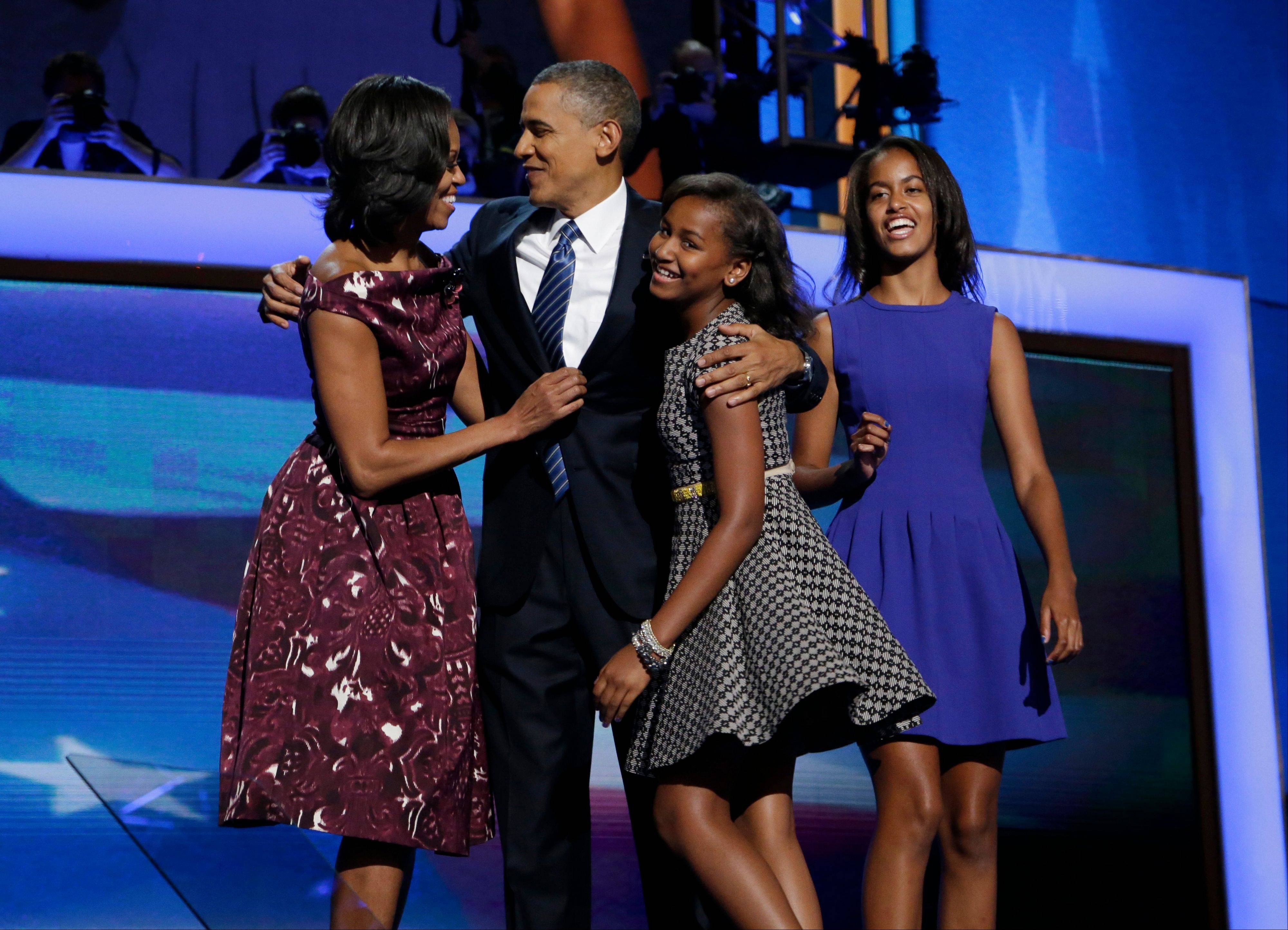President Barack Obama, left, is joined on stage Thursday by first lady Michelle Obama, left, their children Sasha and Malia, right, on the final day of the Democratic National Convention in Charlotte, N.C.
