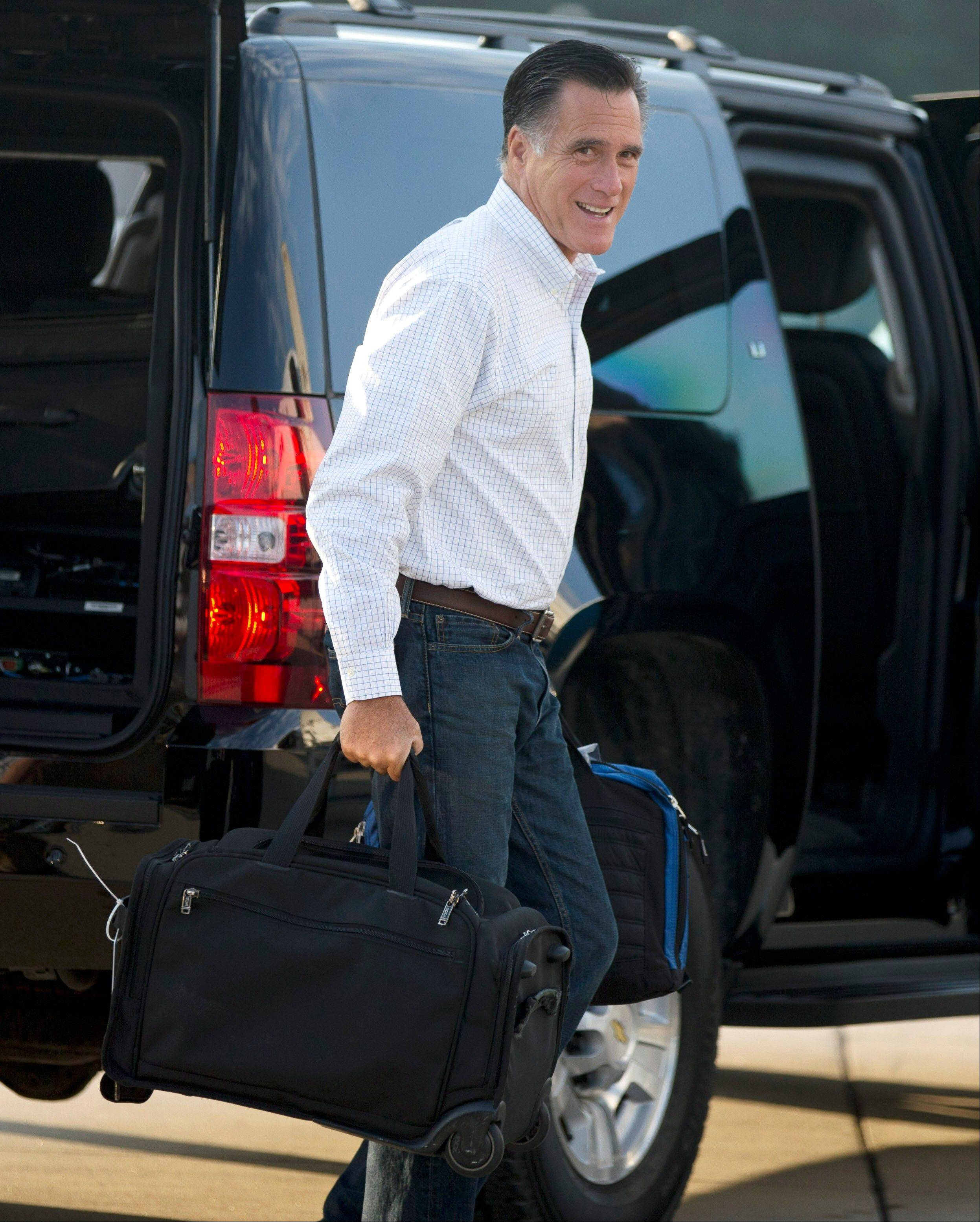 Republican presidential candidate, former Massachusetts Gov. Mitt Romney boards his campaign plane for an event in Iowa on Friday, Sept. 7, 2012 in Portsmouth, N.H.