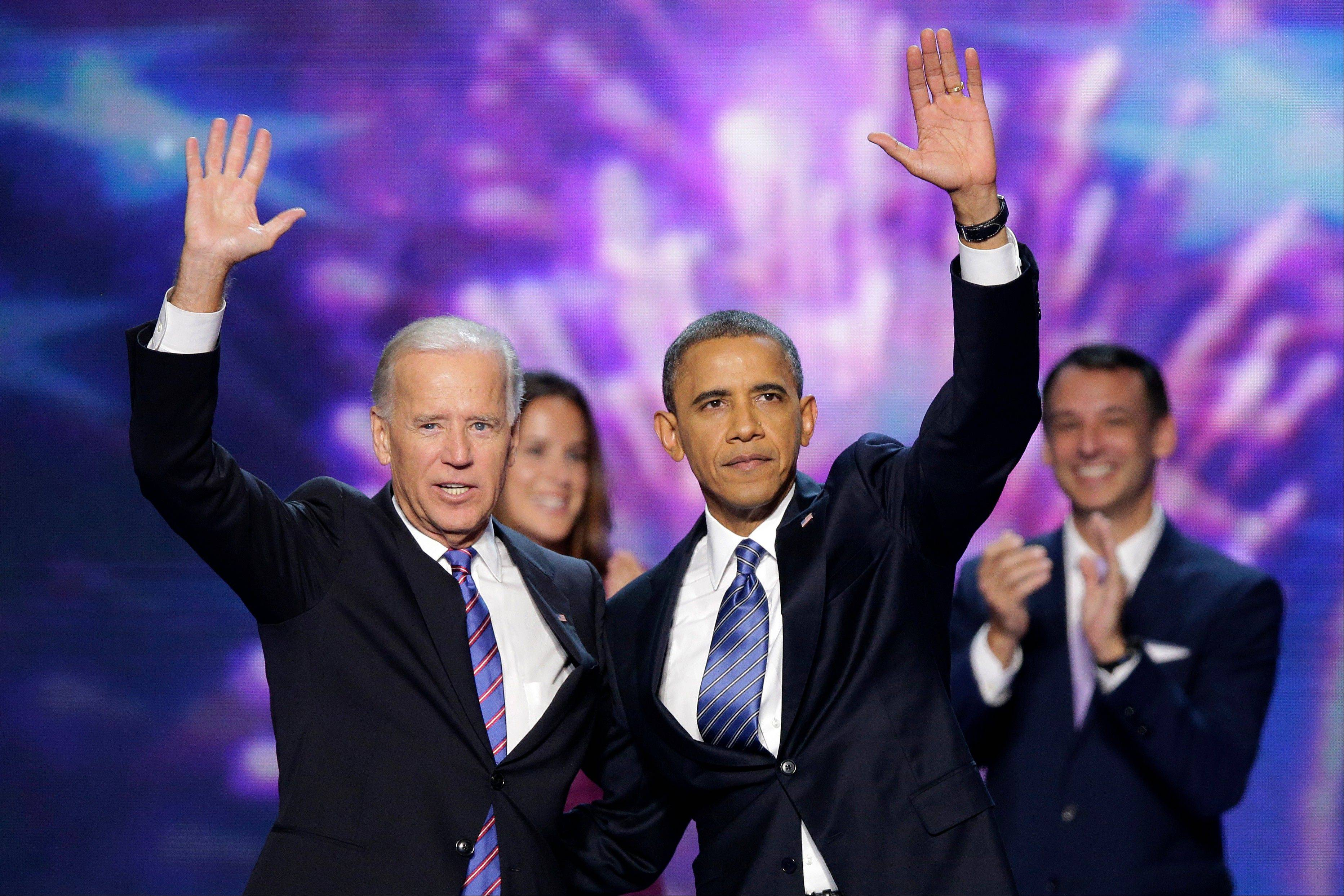 Vice President Joe Biden and President Barack Obama wave to the delegates at the conclusion of Presdident Obama�s speech at the Democratic National Convention in Charlotte, N.C., on Thursday.