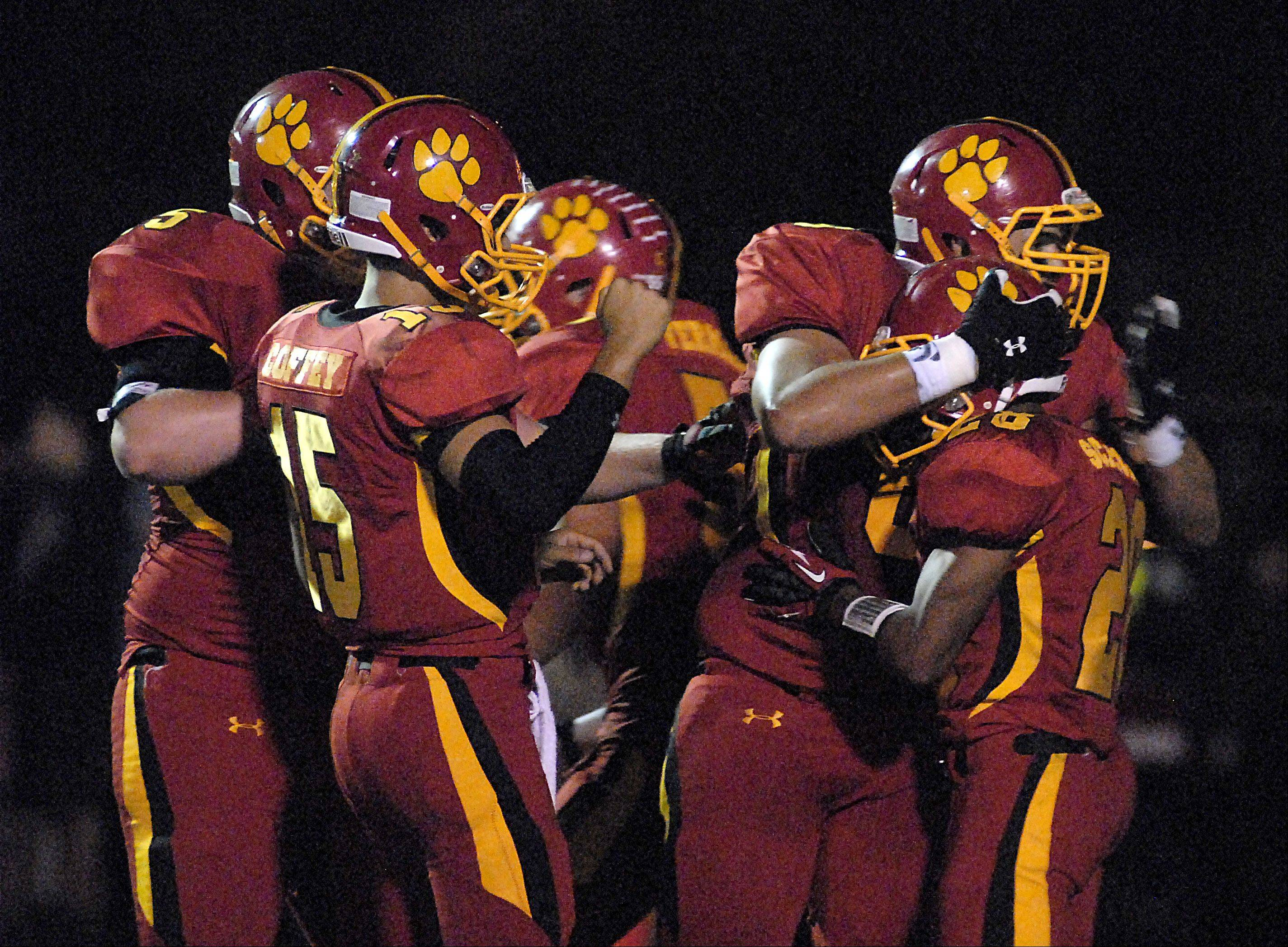 Batavia�s Adam Hunger hugs Anthony Scaccia after a second quarter touchdown.