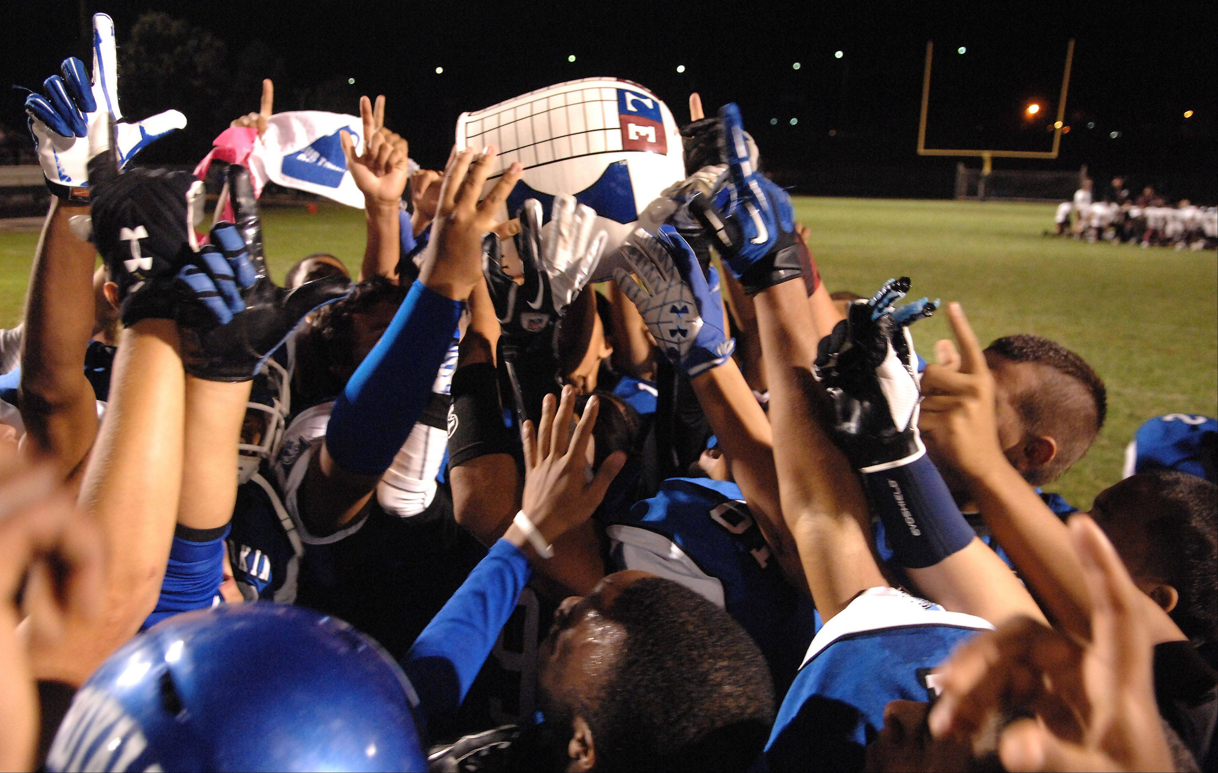 Larkin players celebrate with the jug following their win over Elgin during Friday�s game at Elgin High School.