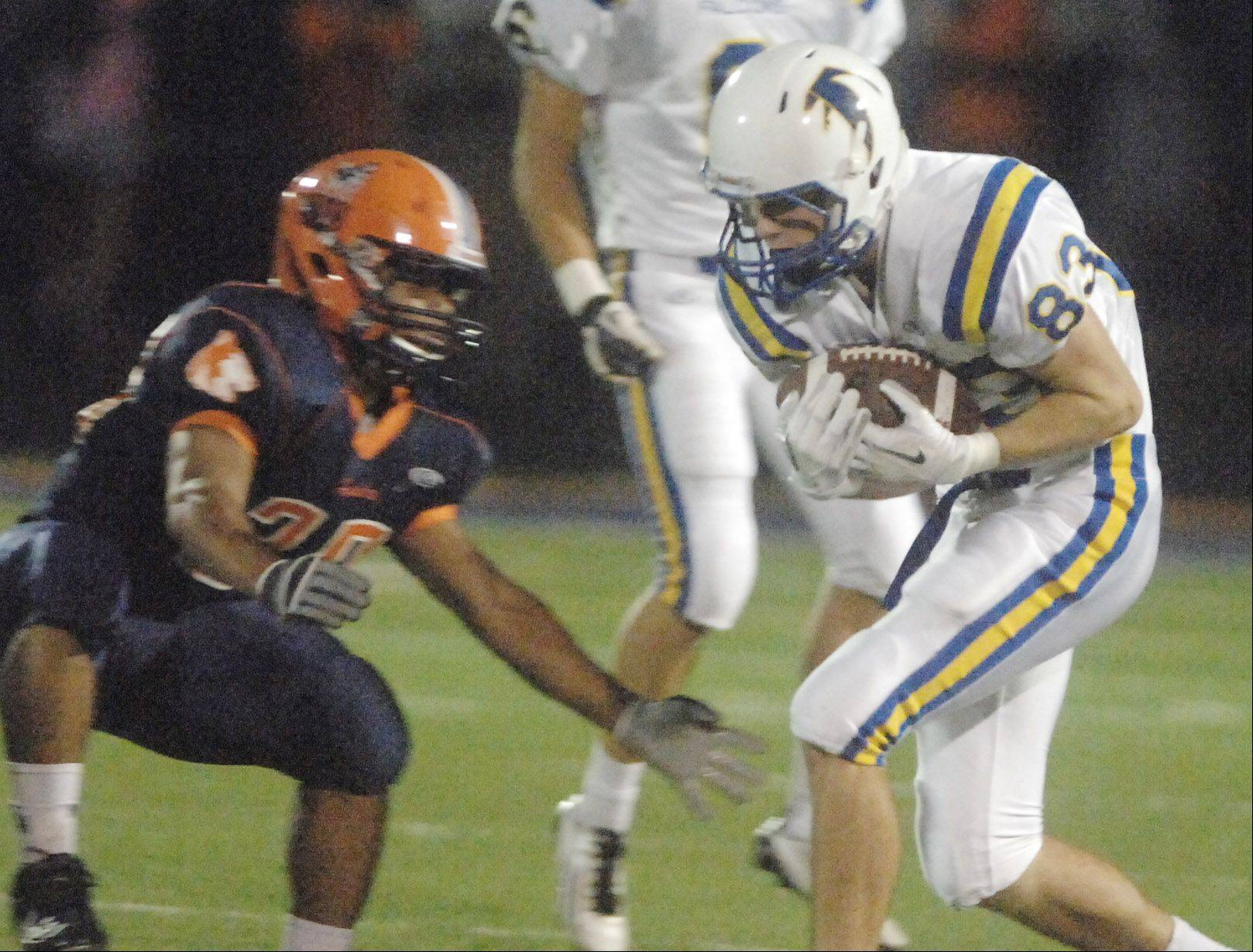 Rashad Crosby of Naperville North,left, gets ready to hit Matt Biegalski of Wheaton North Friday night in Naperville.