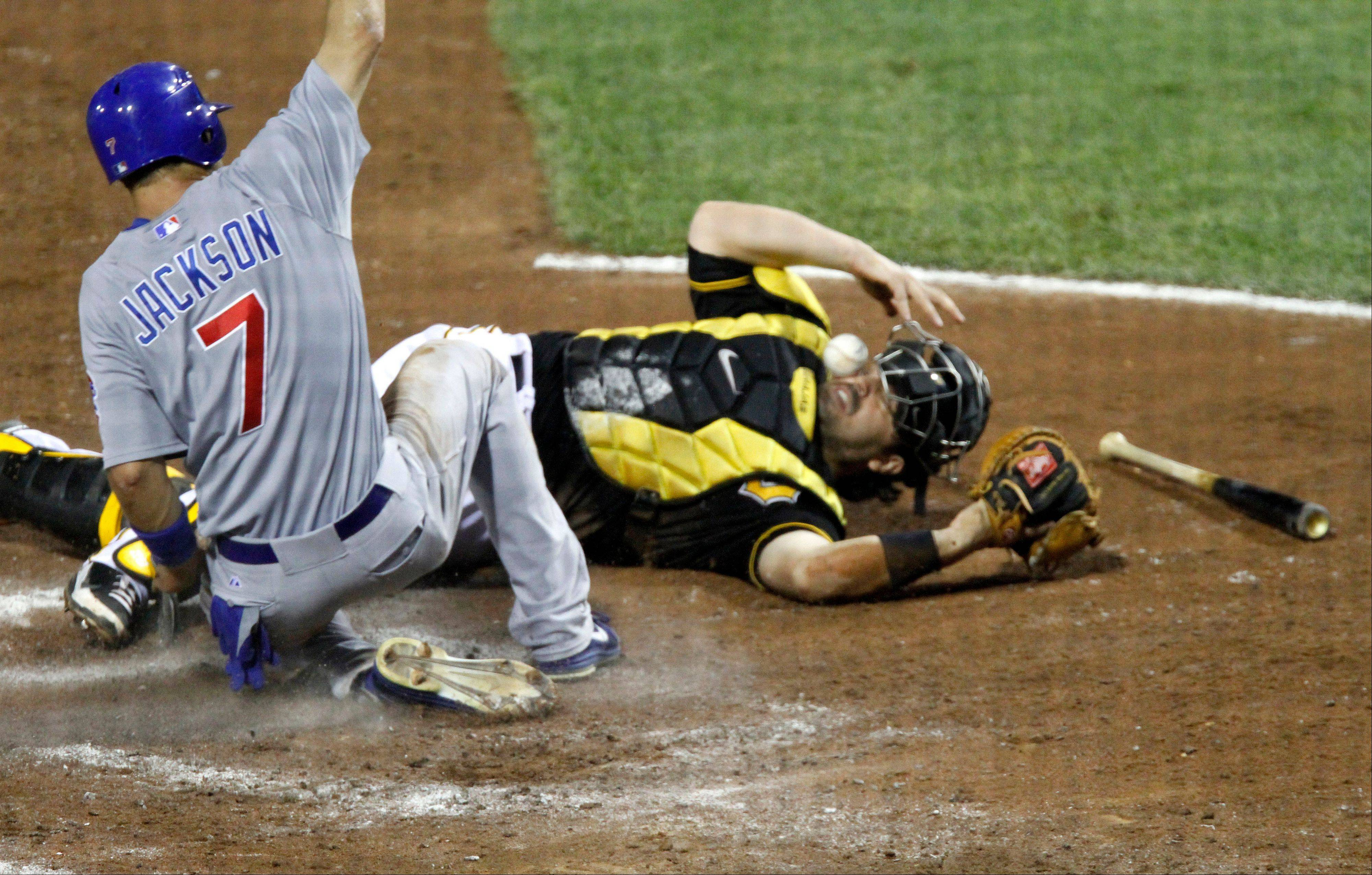 Brett Jackson scores as Pittsburgh Pirates catcher Rod Barajas loses the ball on the throw from first baseman Gaby Sanchez in the sixth inning Friday.