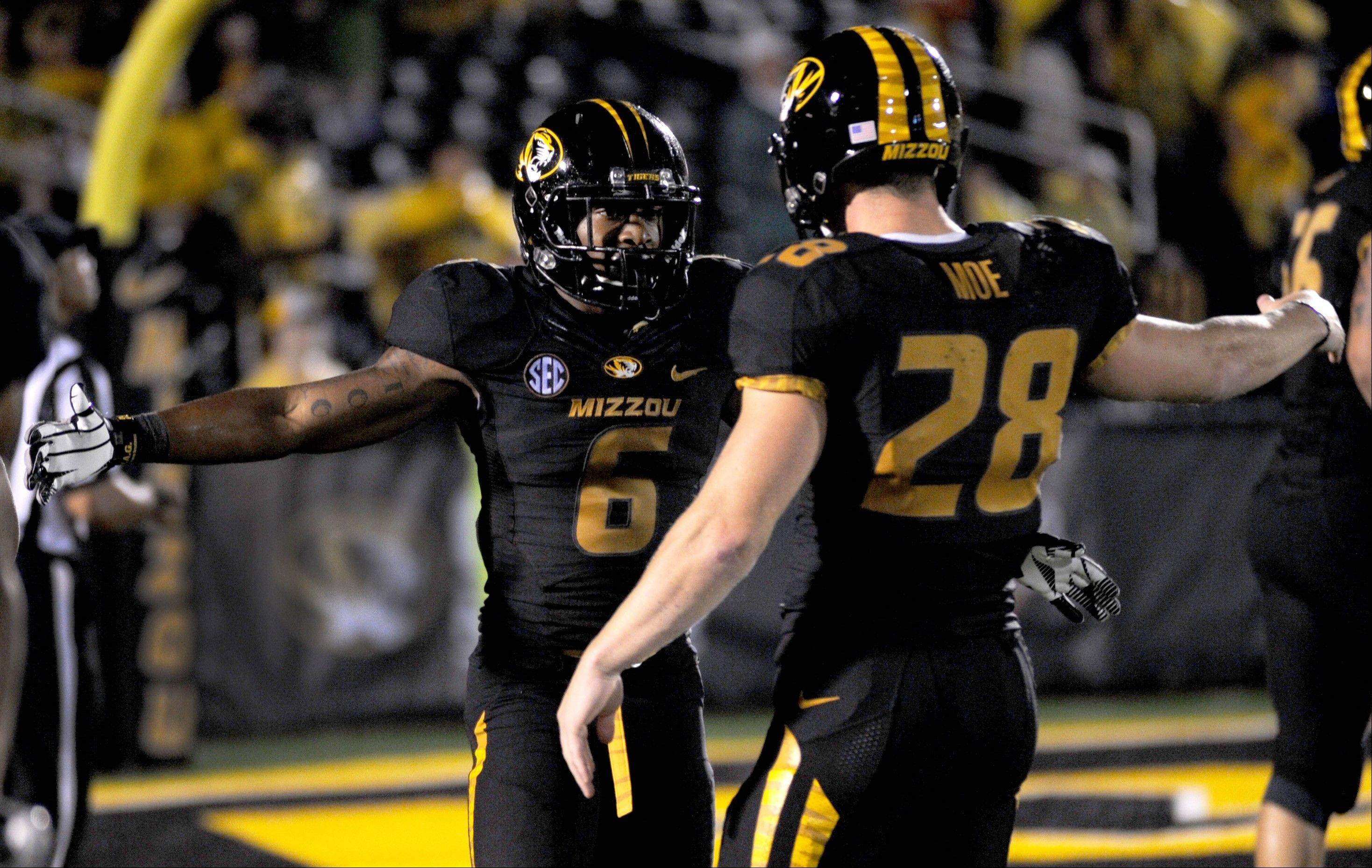 Missouri�s Marcus Murphy, left, is congratulated by teammate T.J. Moe for running a punt back 72 yards for a touchdown last Saturday at home against Southeastern Louisiana.