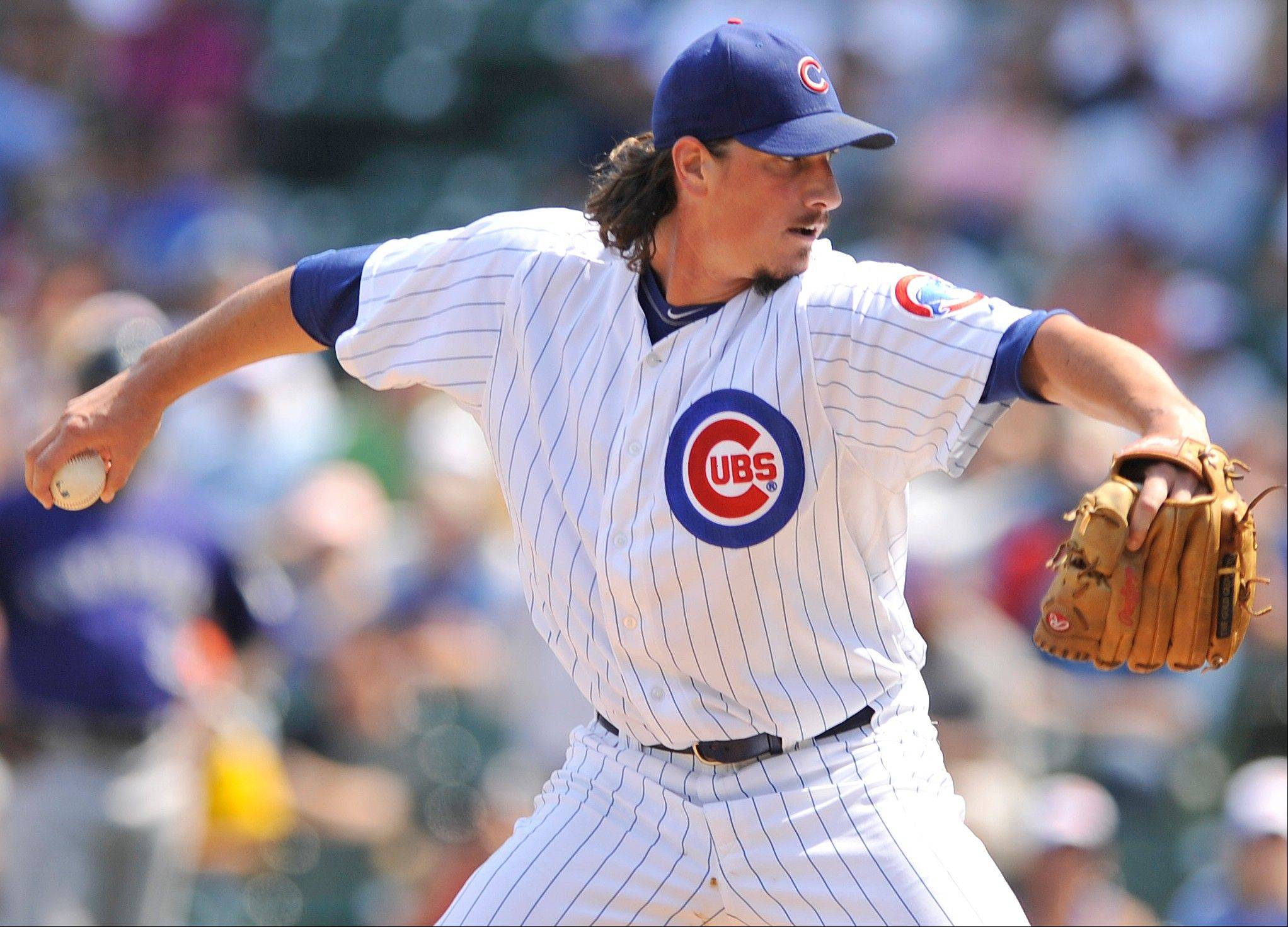 Chicago Cubs starter Jeff Samardzija delivers a pitch against the Colorado Rockies in the first inning during a baseball game in Chicago, Friday, Aug. 24, 2012. (AP Photo/Paul Beaty)