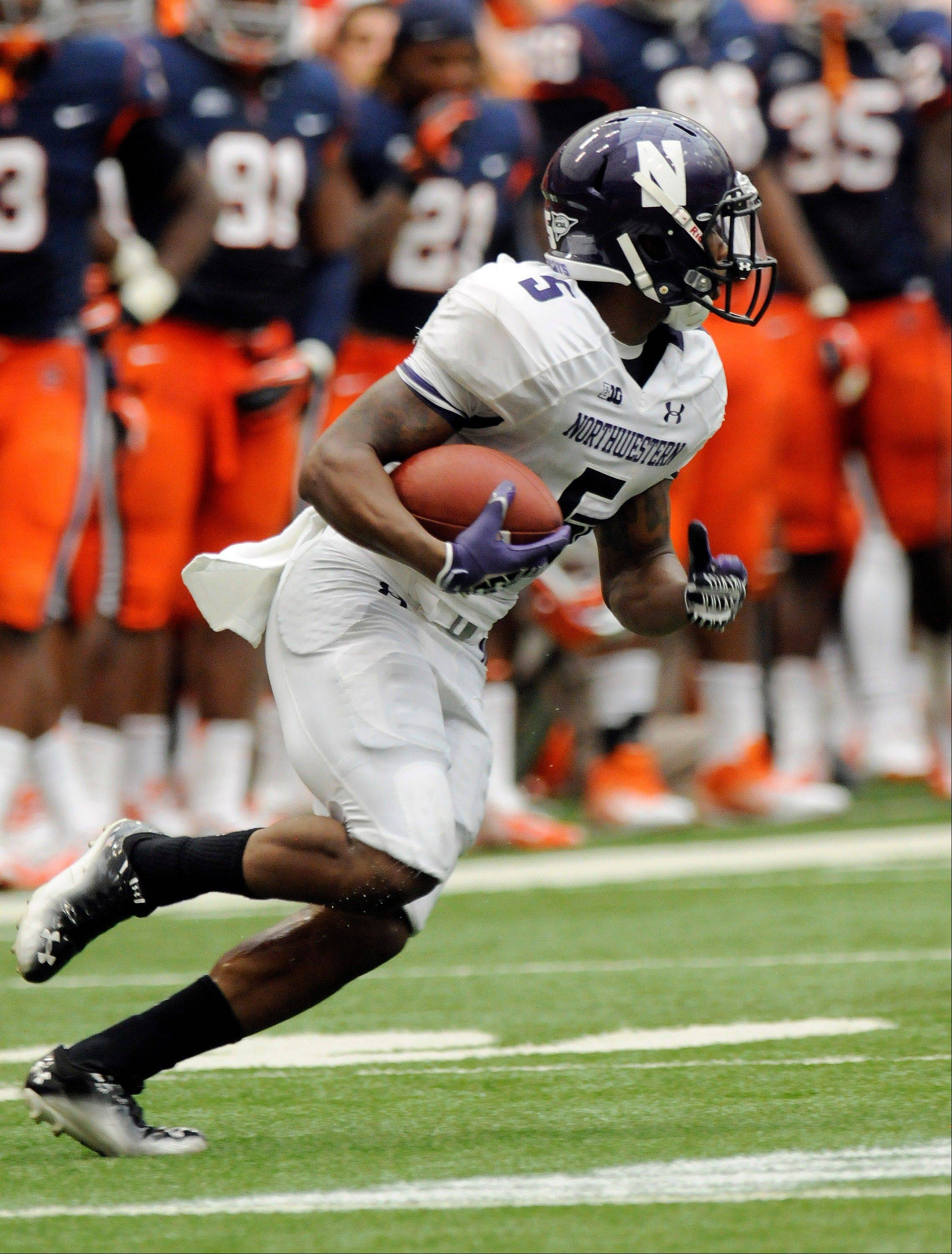 Northwestern�s Venric Mark returns a kick for a touchdown against Syracuse�s during last Saturday�s road game.