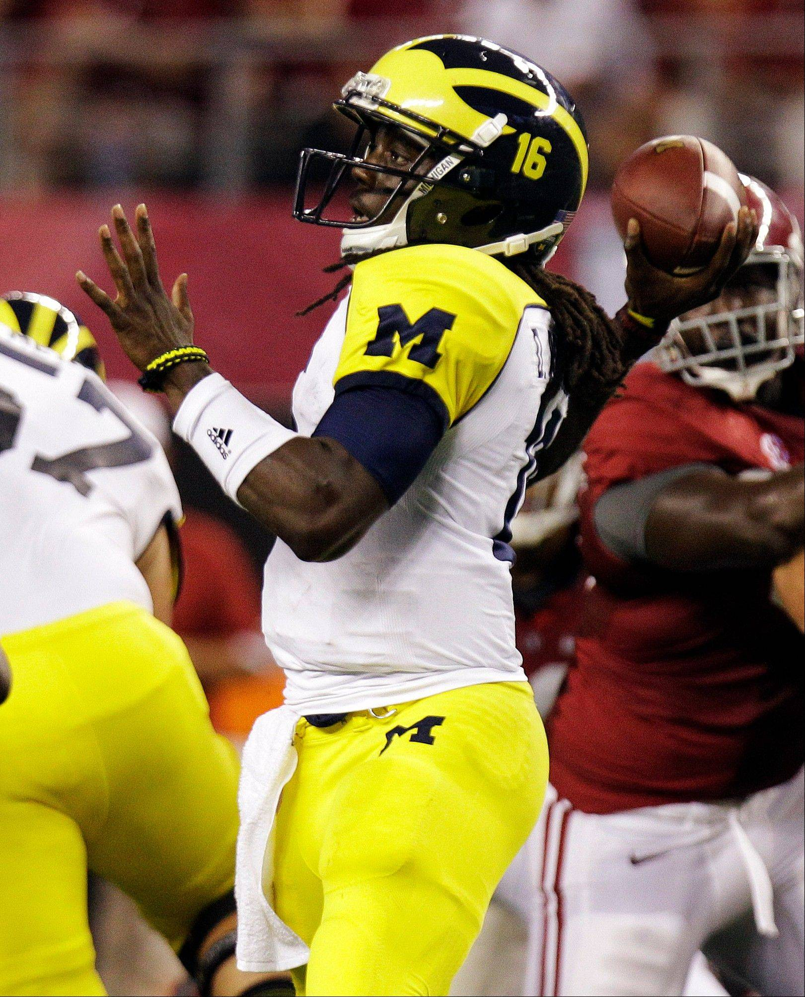 Michigan quarterback Denard Robinson passes during the first half of last Saturday�s loss to Alabama at Cowboys Stadium in Arlington, Texas.