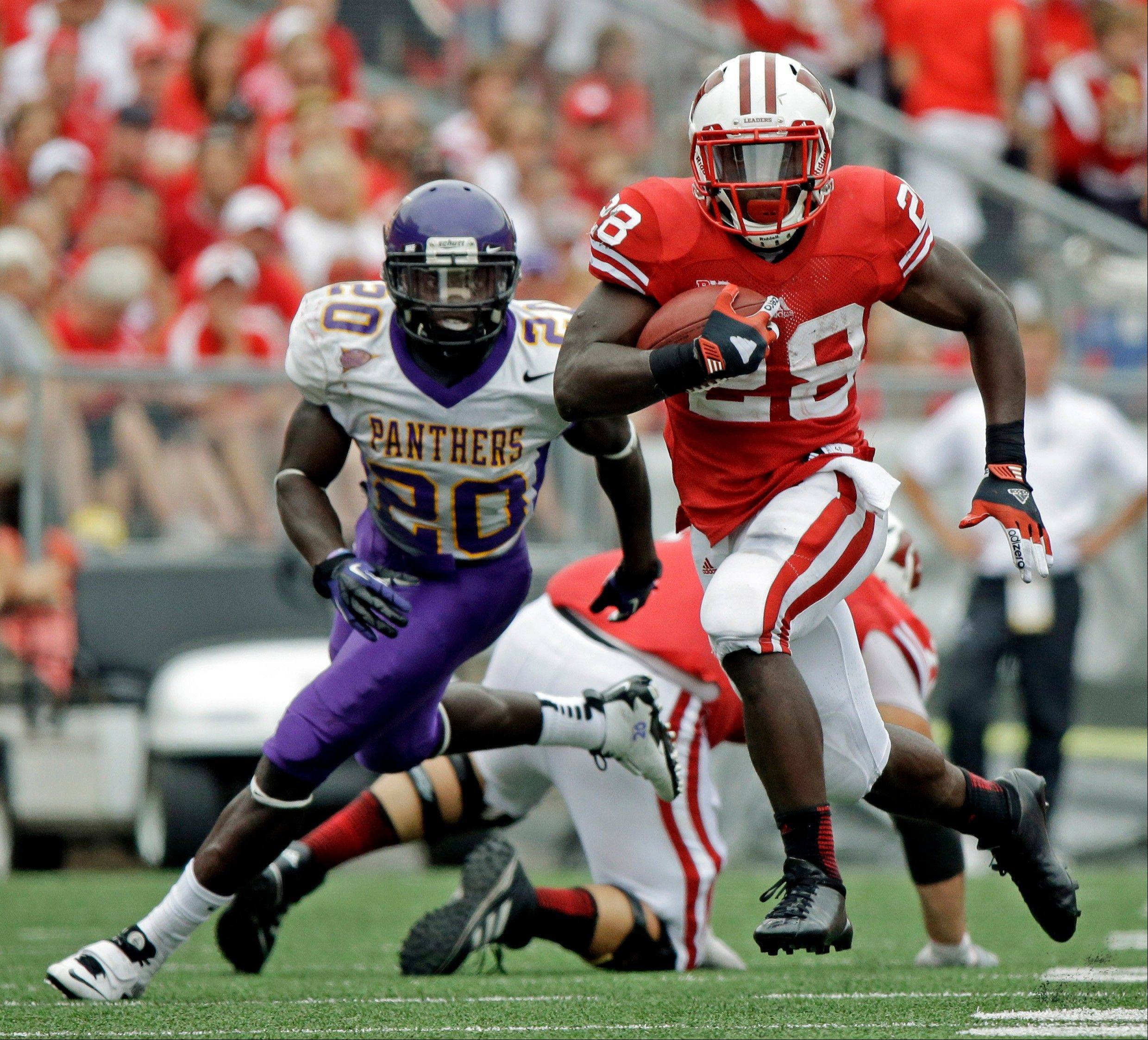 Wisconsin�s Montee Ball breaks away from Northern Iowa�s Wilmot Wellington for a 16-yard pass reception during the second half last Saturday in Madison.
