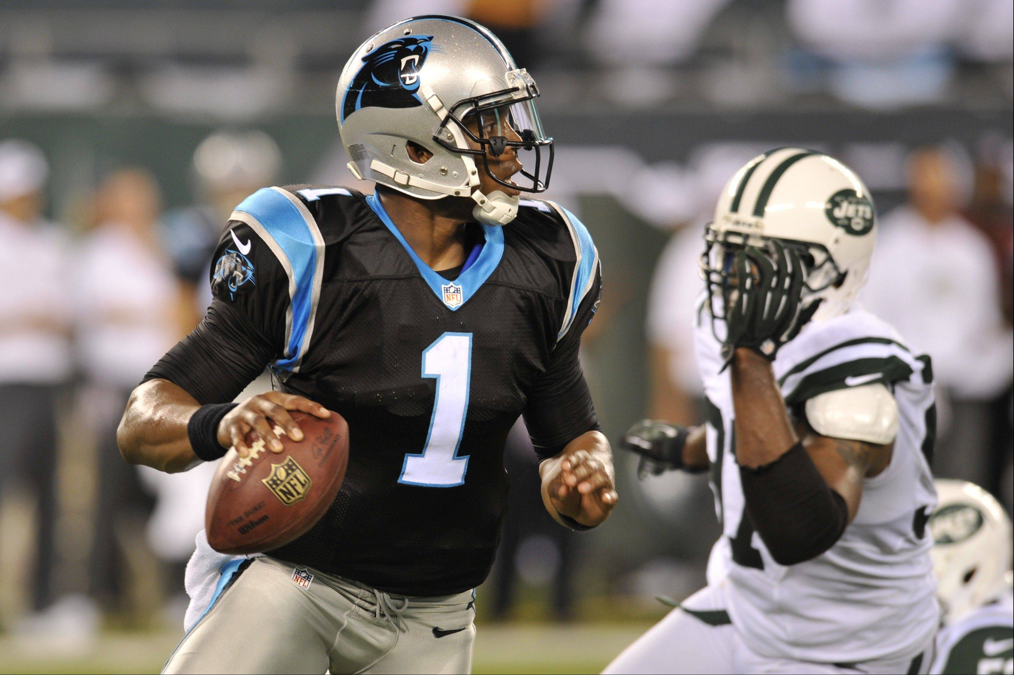 Carolina Panthers quarterback Cam Newton (1) set an NFL rookie record with 4,051 yards last season and accounted for 35 touchdowns.