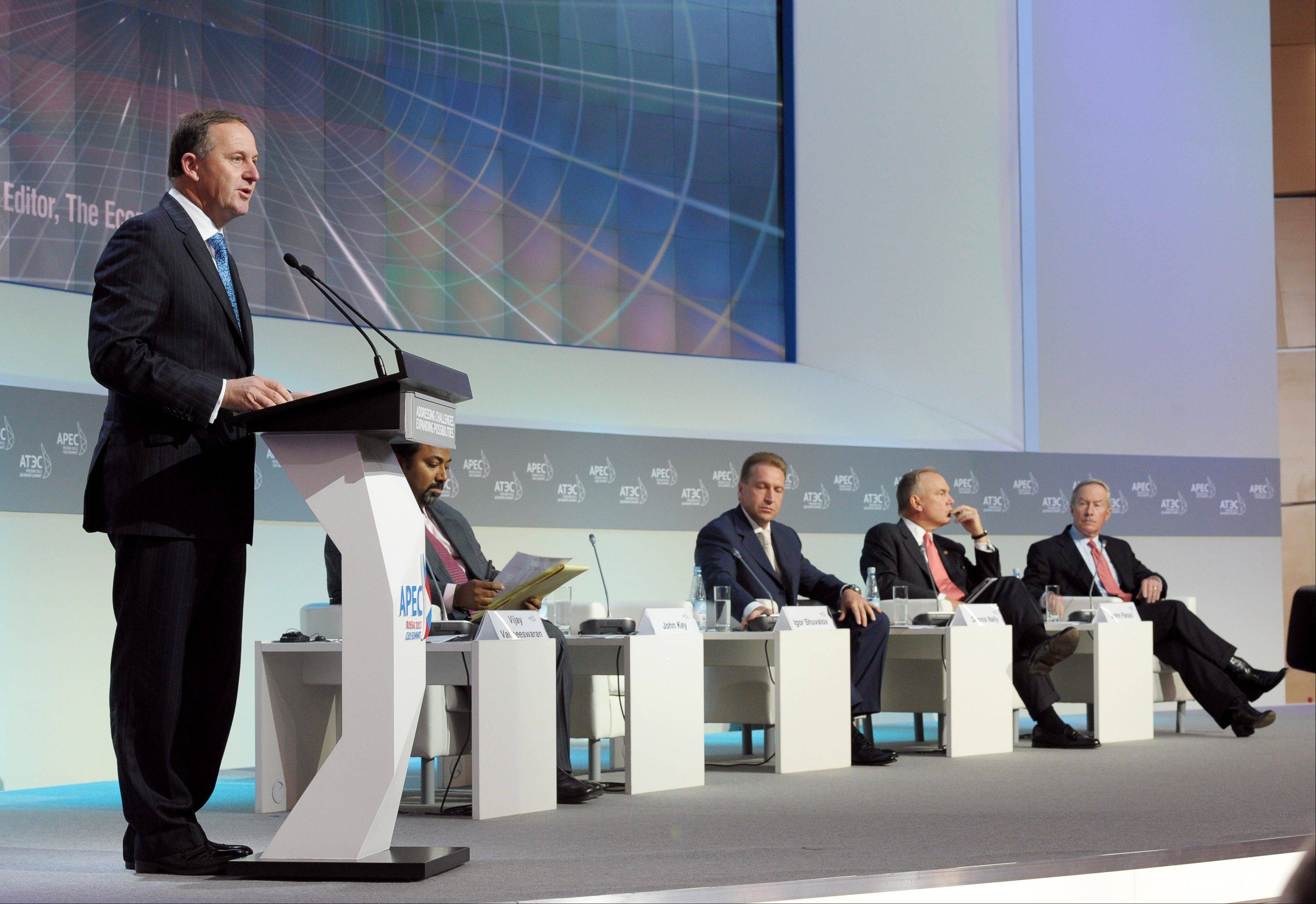 New Zealand Prime Minister John Key addresses the APEC summit.
