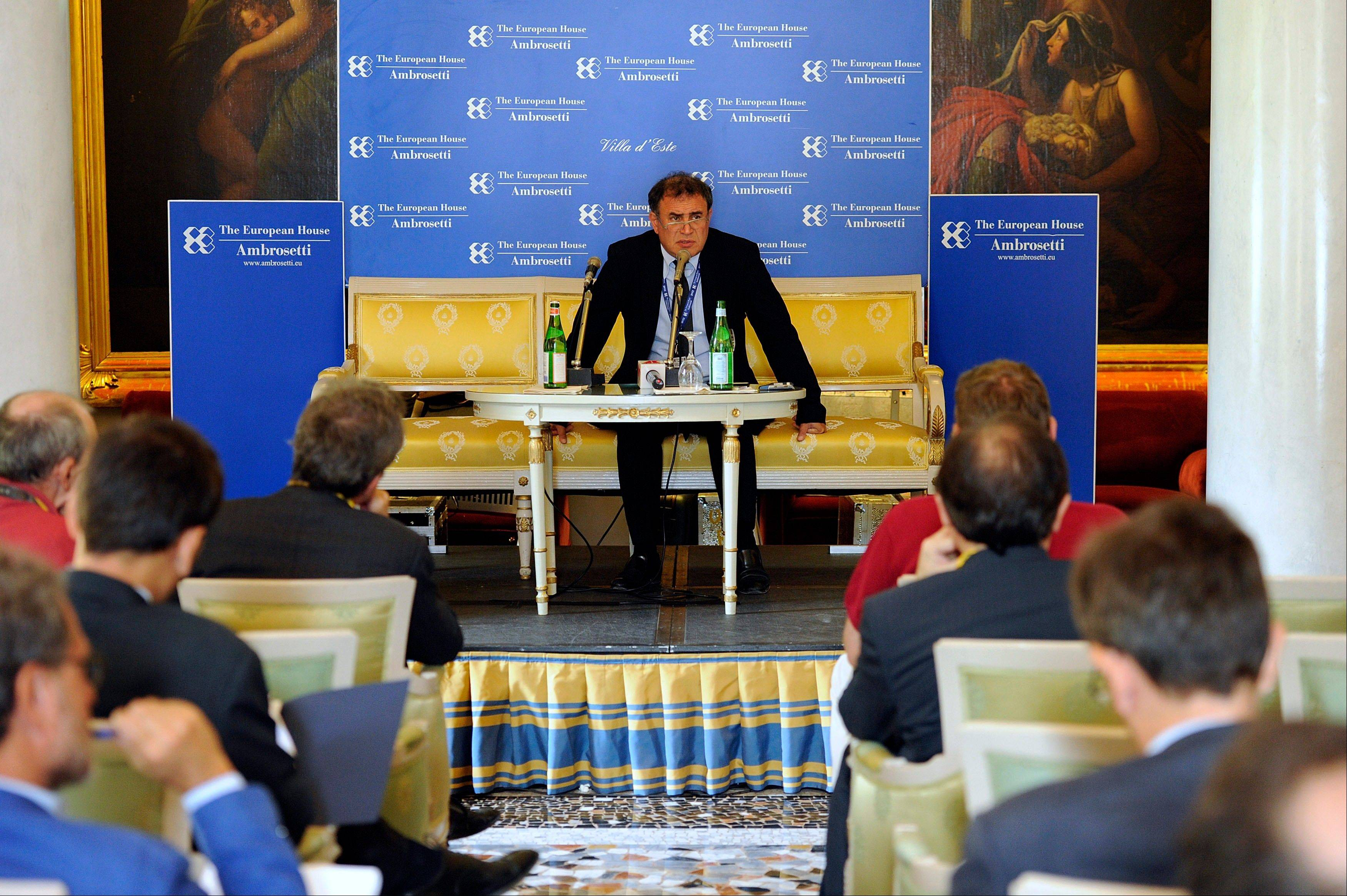 U.S. economist Nouriel Roubini, center, speaks during a meeting Friday on the world economy in Cernobbio, Italy.