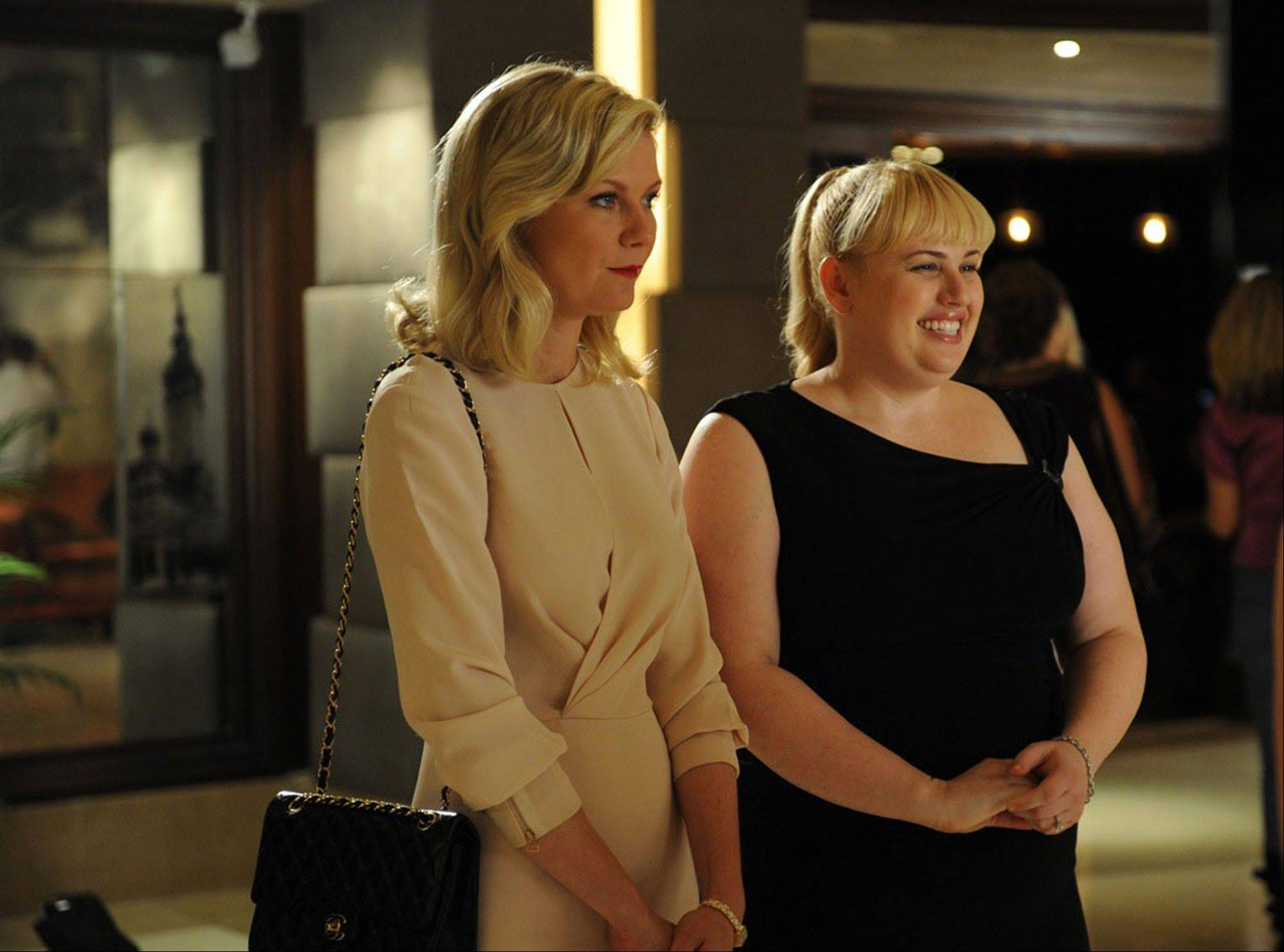 "Kirsten Dunst, left, stars with Rebel Wilson, who plays Becky, a sweet, beaming bride -- the first of her friends to marry -- in the dark comedy ""Bachelorette."""