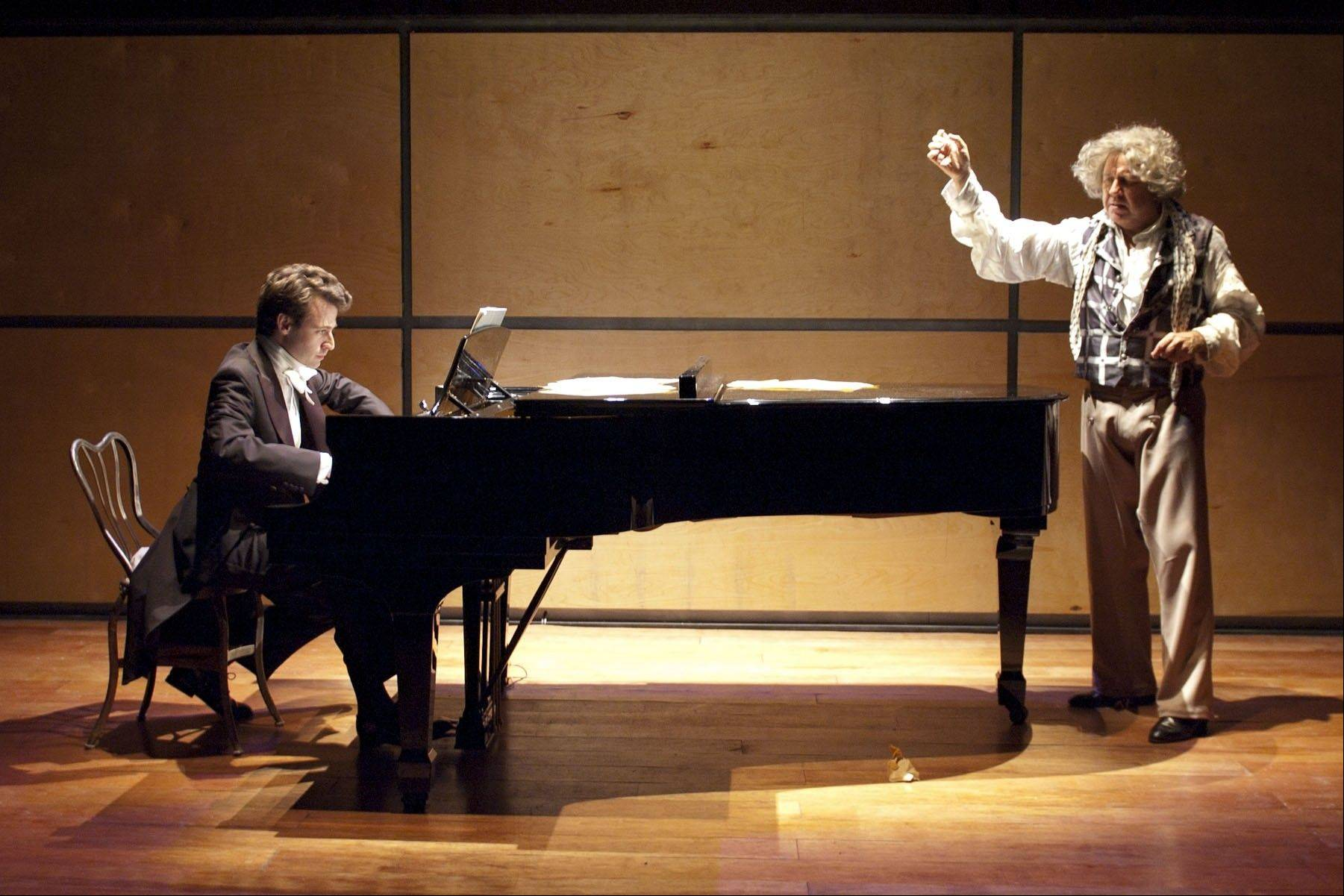 "Beethoven (Terry Hamilton, right) obsesses over teasing the last bit of music out of a minor waltz by Anton Diabelli in TimeLine Theatre's ""33 Variations"" featuring pianist George Lepauw."