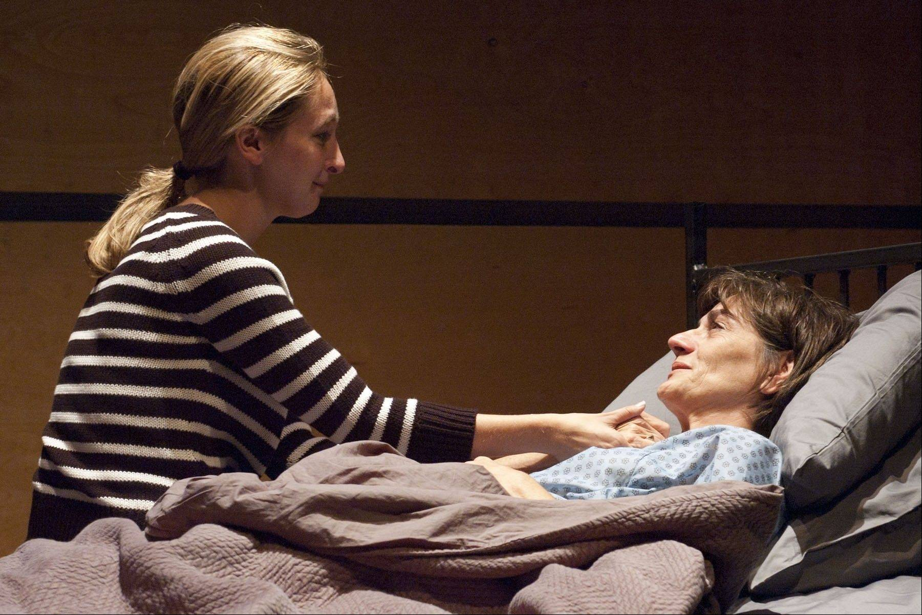 "As her life draws to an end, Katherine Brandt (Janet Ulrich Brooks, right) and her daughter Clara (Jessie Fisher) spend the most valuable currency -- time -- in Nick Bowling's Chicago-area premiere of Moises Kaufman's ""33 Variations"" at TimeLine Theatre."