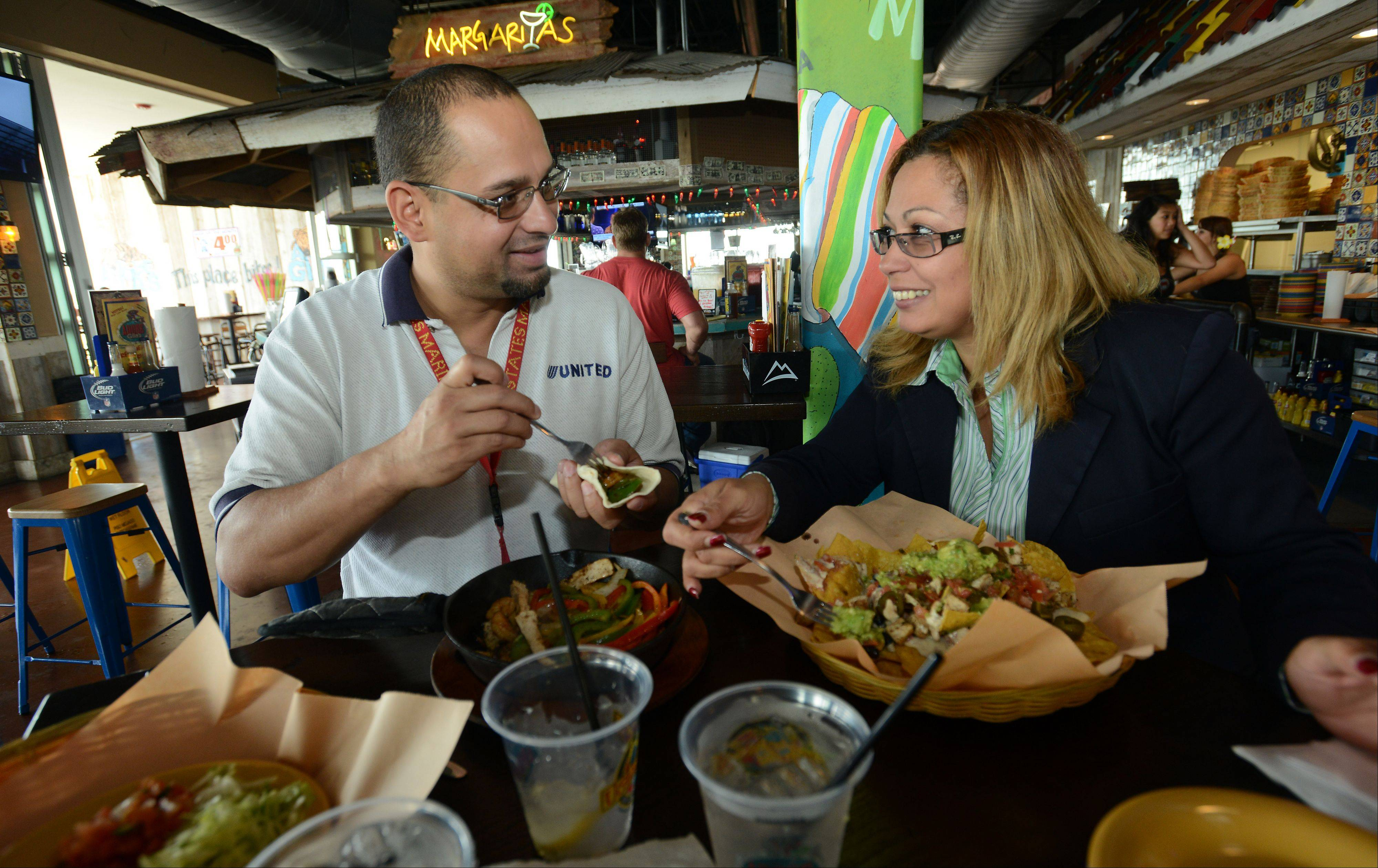 Maria Caraballo of Chicago and Gilbert Barrera of Mount Prospect enjoy lunch at Adobe Gila's in Rosemont.