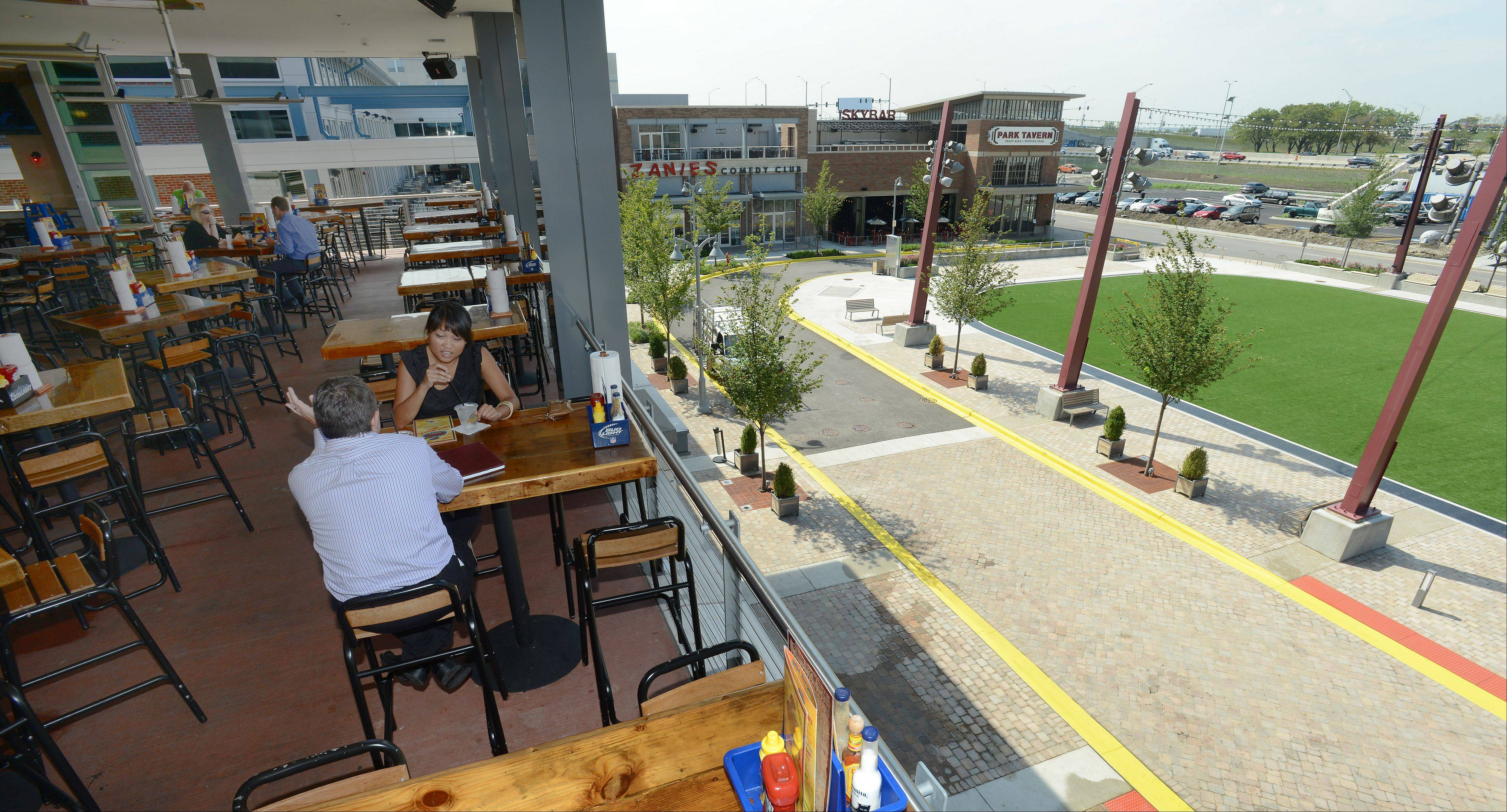 Adobe Gila's open dining room offers a view of the park in Rosemont's new entertainment district.