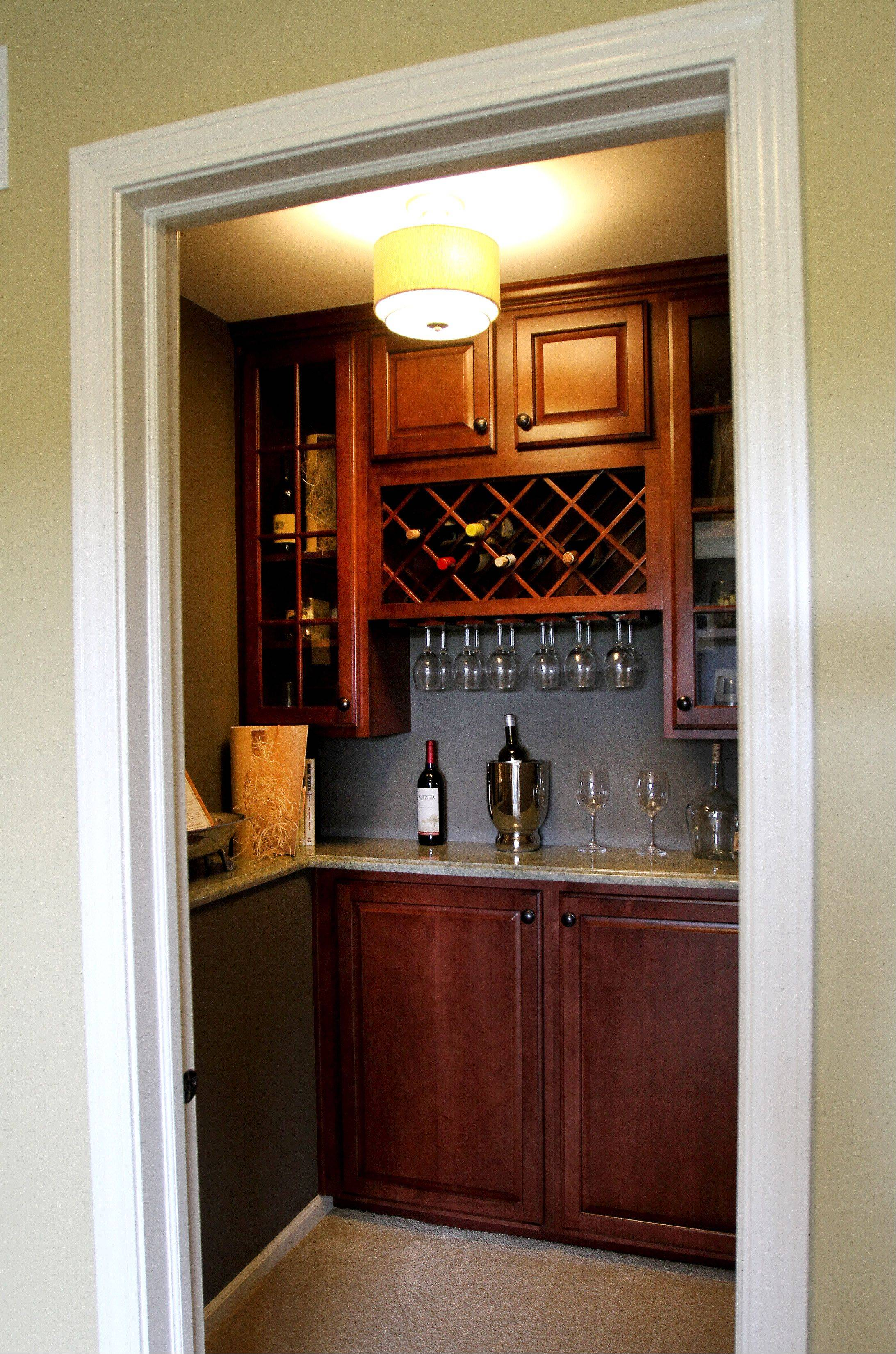 Many open floor plans tuck away a small room than can be used for an office or flex space, to be furnished however a homeowner wants. This wine bar is in a small alcove in the Cardiff model at Easton Park in Carol Stream.