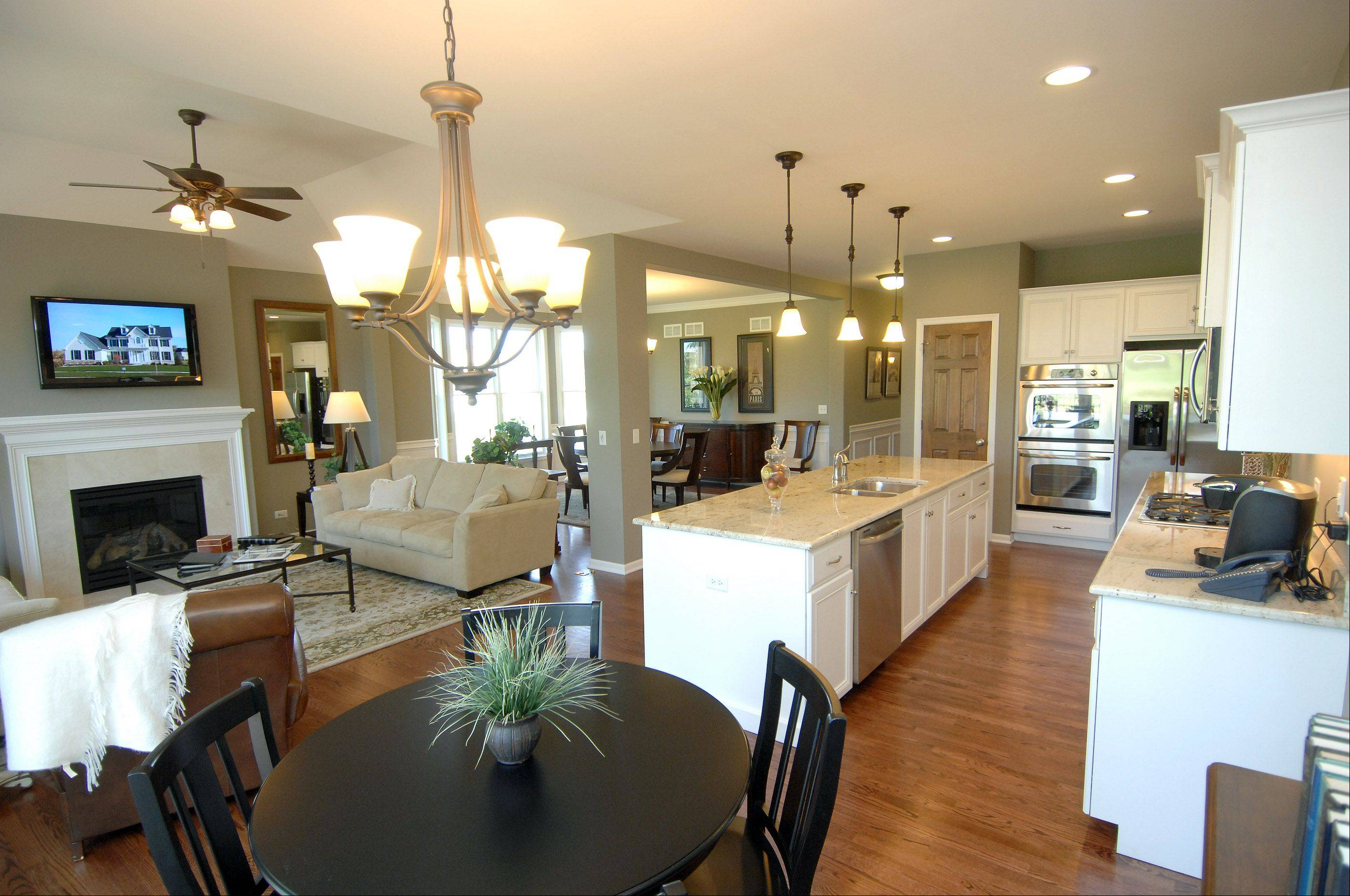 "Most of today's newest homes have open floor plans on the lower level, combining dining, kitchen and gathering areas into one ""great"" space. This is the model home at Fisher Farm in Winfield."