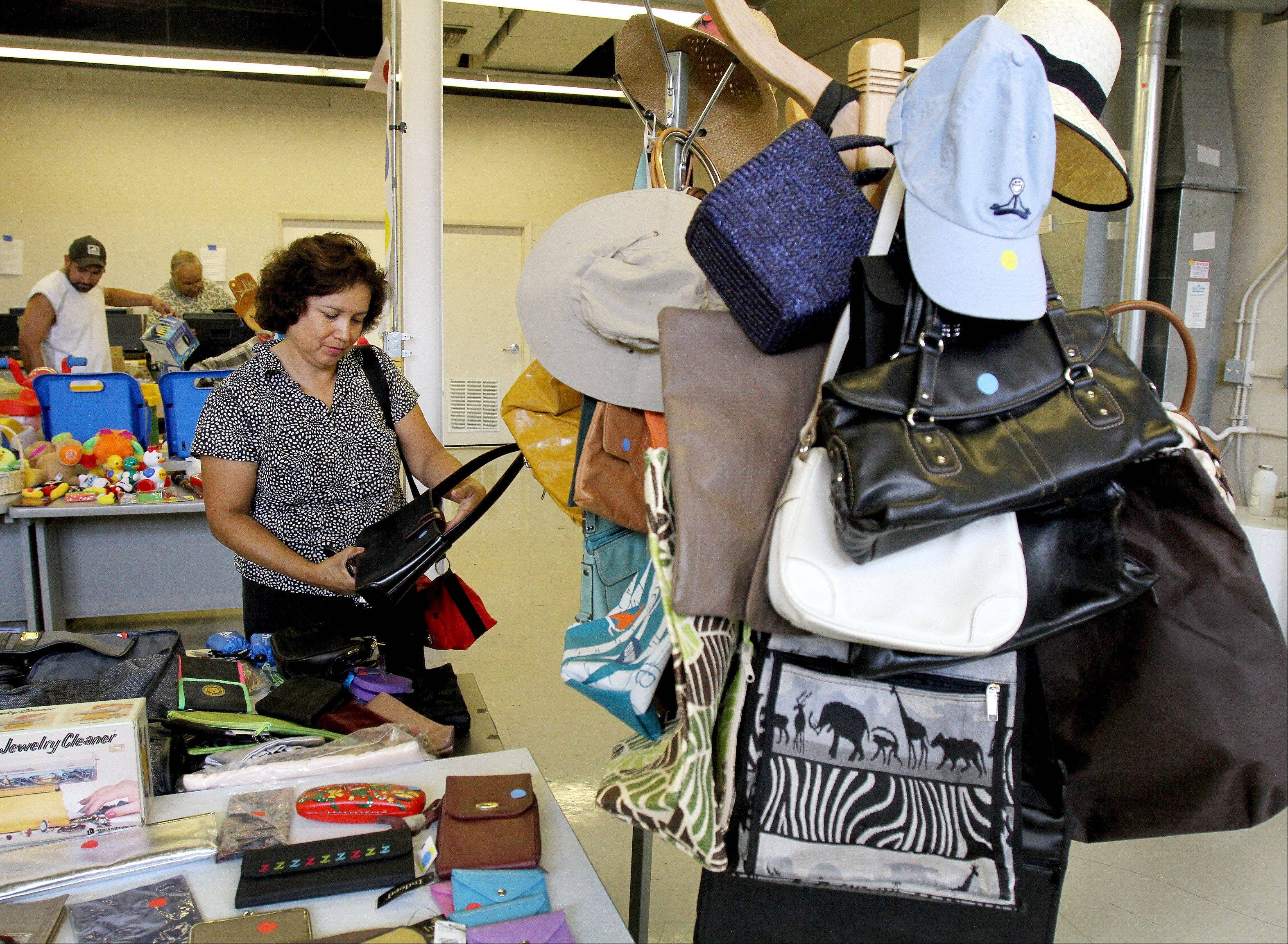 Elsa Maust of Wheaton takes a look at some items for sale at Allured Business Media in Carol Stream.