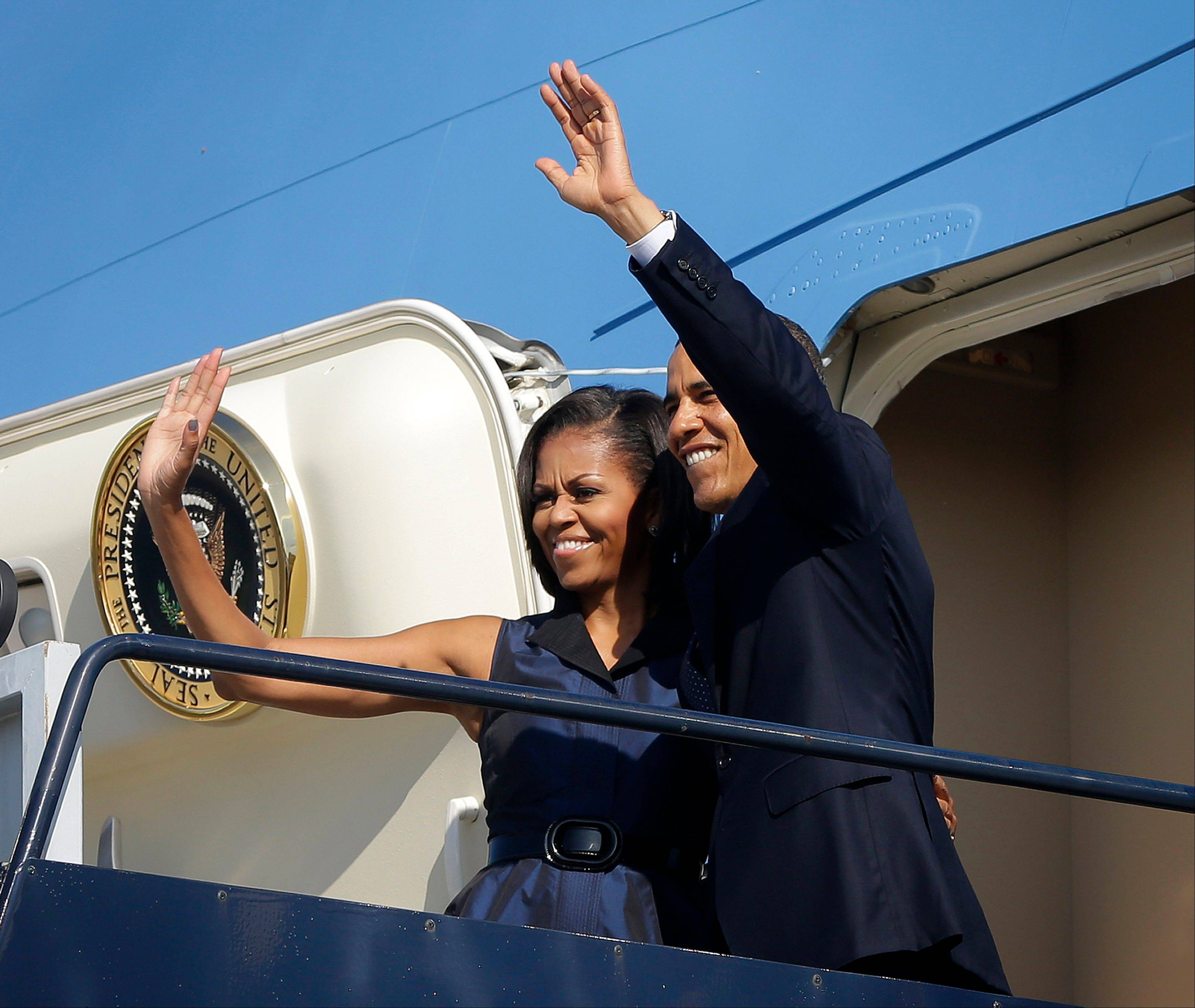 President Barack Obama and first lady Michelle Obama, wave as they board Air Force One before their departure from Charlotte International Airport, Friday, Sept. 7, 2012, in Charlotte, N.C.