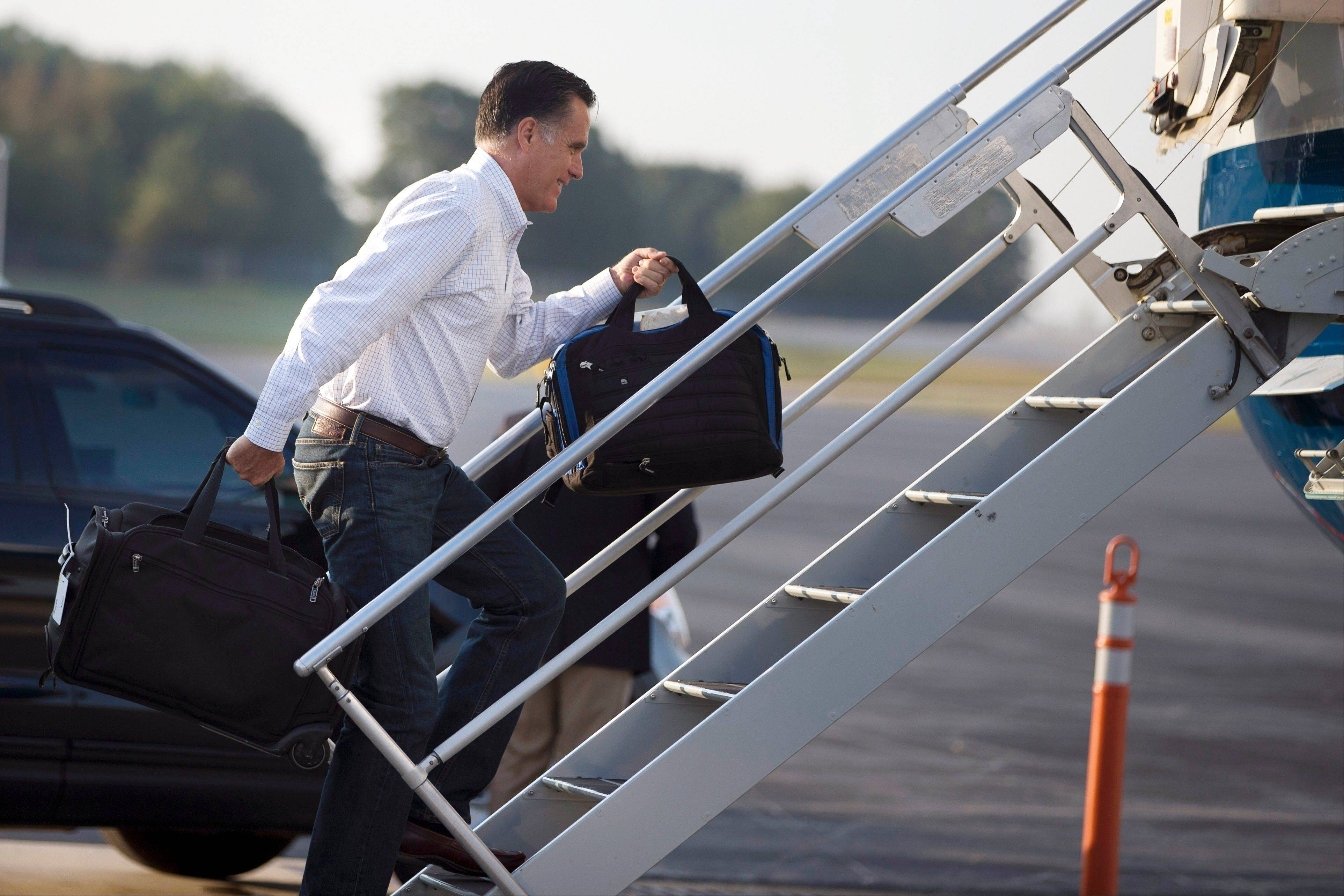 Republican presidential candidate, former Massachusetts Gov. Mitt Romney boards his campaign plane for an event in Iowa on Friday, Sept. 7, 2012 in Portsmouth, N.